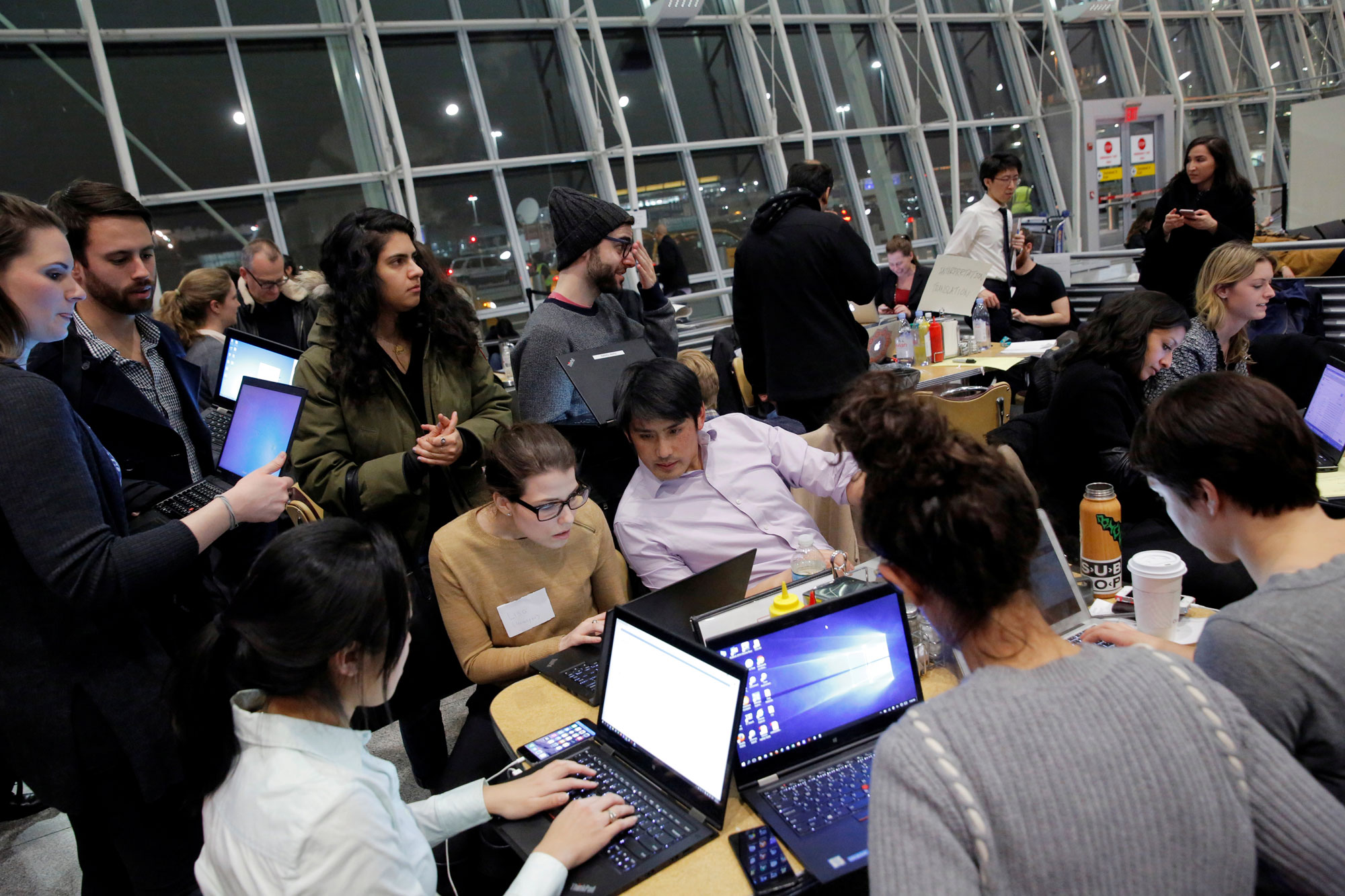 Volunteer lawyers work in a dining area of Terminal 4 to assist travelers detained as part of Donald Trump's travel ban in Terminal 4 at John F. Kennedy International Airport.