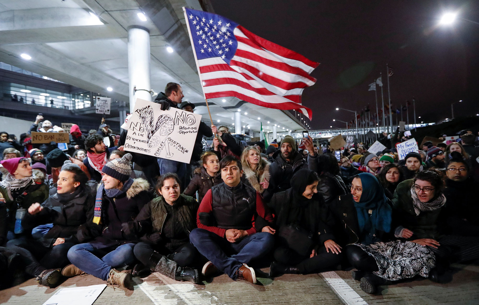 People gather to protest against the travel ban imposed by President Donald Trump's executive order, at O'Hare airport in Chicago.