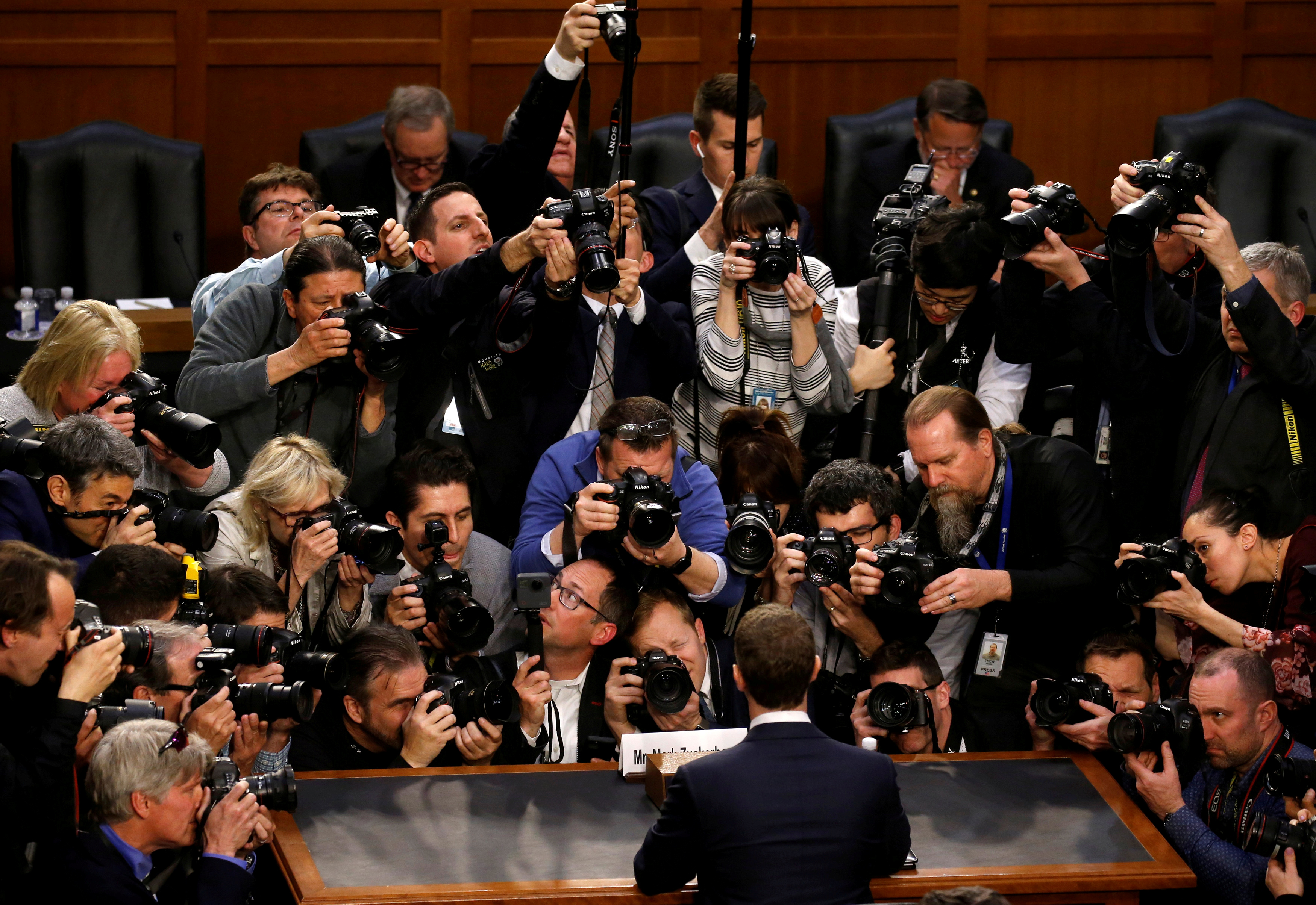 The picture show's the back of Facebook CEO Mark Zuckerberg who is surrounded by photographers.