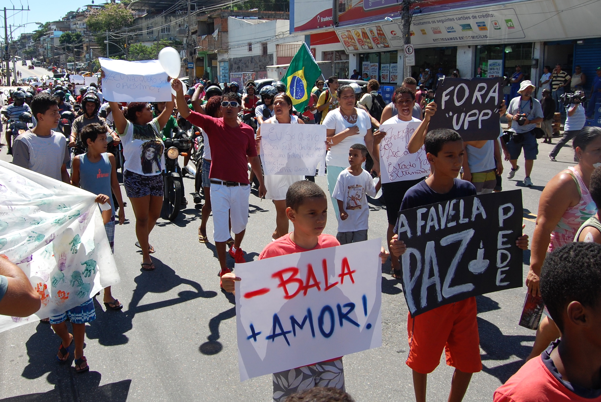 Favela residents march in a protest against the pacification police program in Rio de Janeiro.