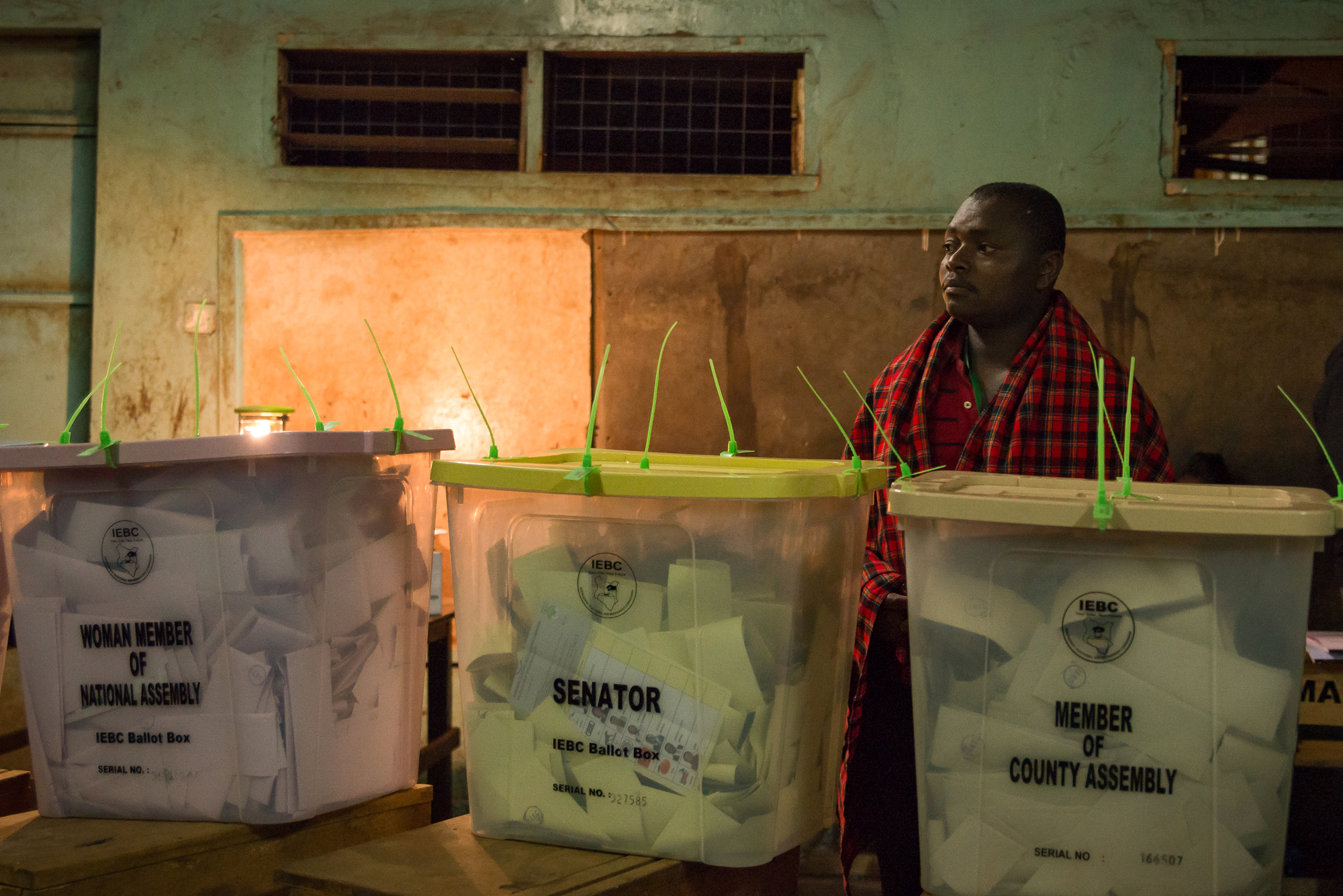 An election official wait for confirmation to begin counting votes for Kenya's next president in Nairobi, Kenya.