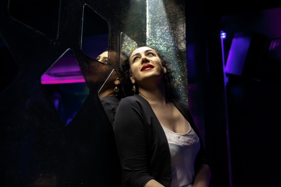 Huzun Coskun, a transgender 30-year-old, is a bar tender at a bar called No Name.