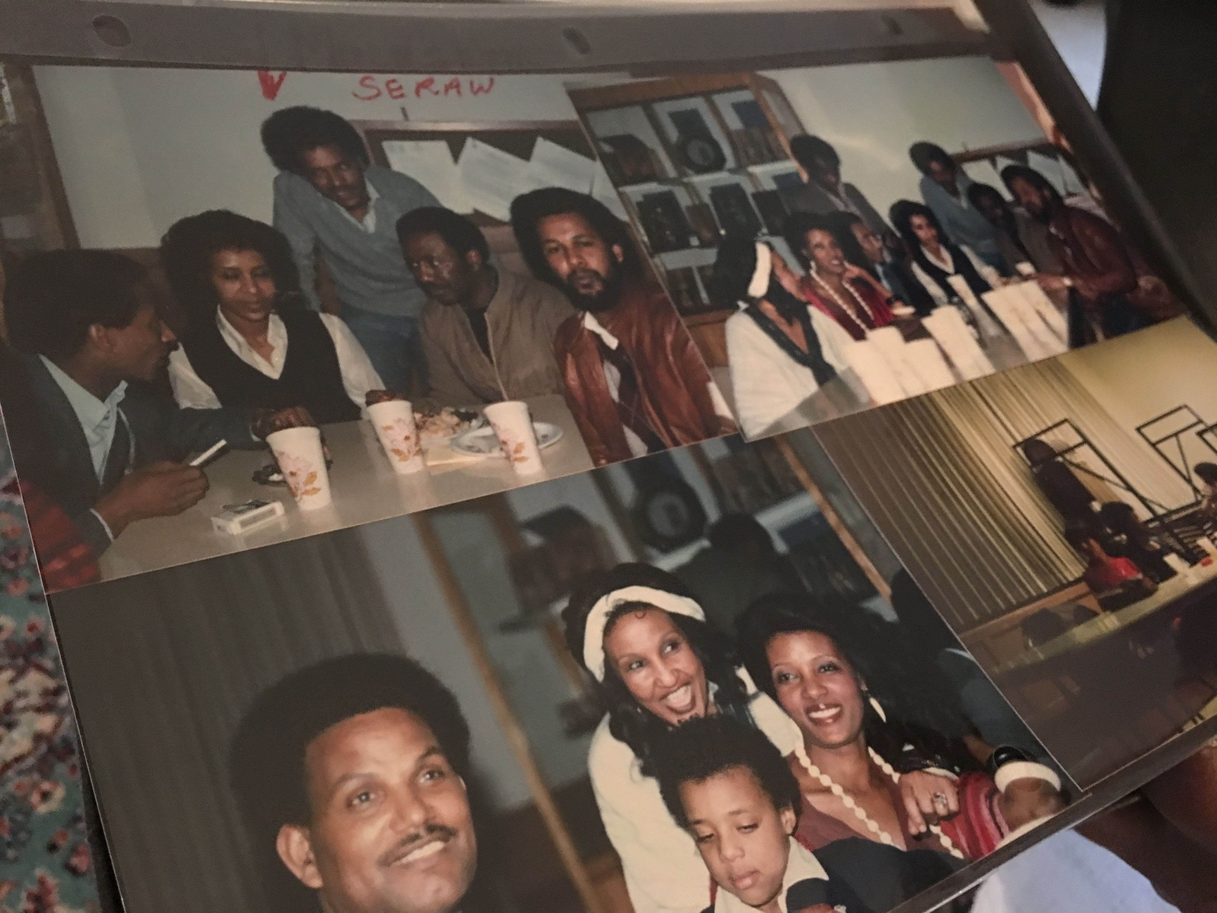 Endeyu Kendie holds pictures of the Portland Ethiopian community in the 1980s, including Mulugeta Seraw, a 28-year-old who became an integral part of the city's racial history.