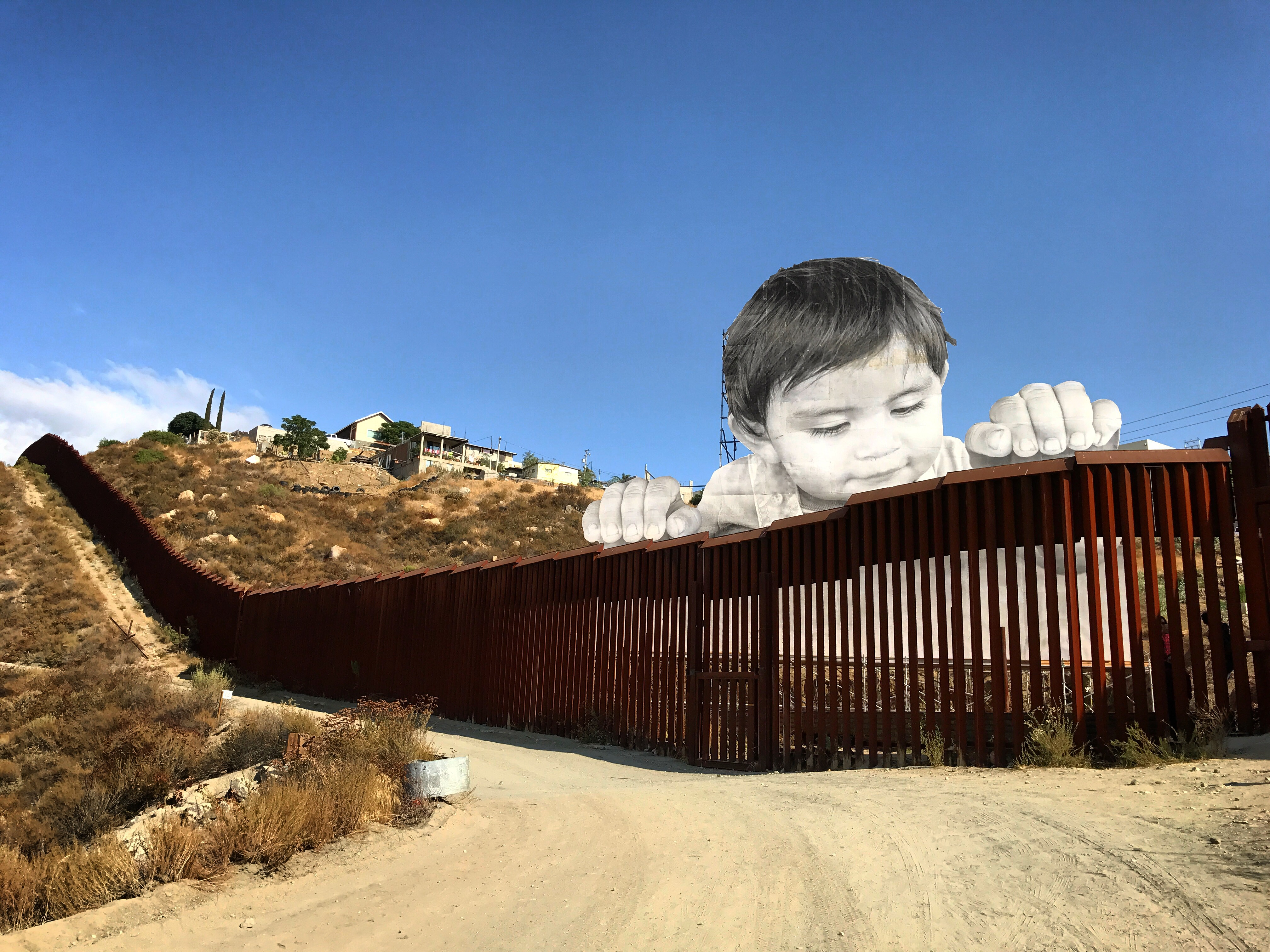 Long stretch of wall with large image of baby look over top
