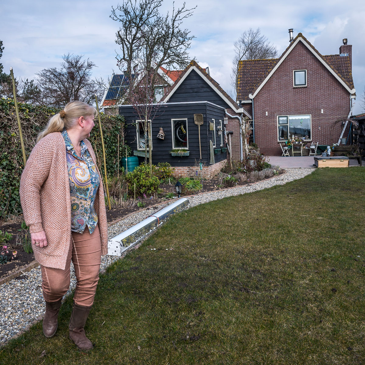 """Anneke van Lelieveld's house sits atop a dike near a """"room for the river"""" project in Noordwaard, the Netherlands. She understands the need for a new approach to managing water in this new era of climate change, but misses the neighbors that the project di"""