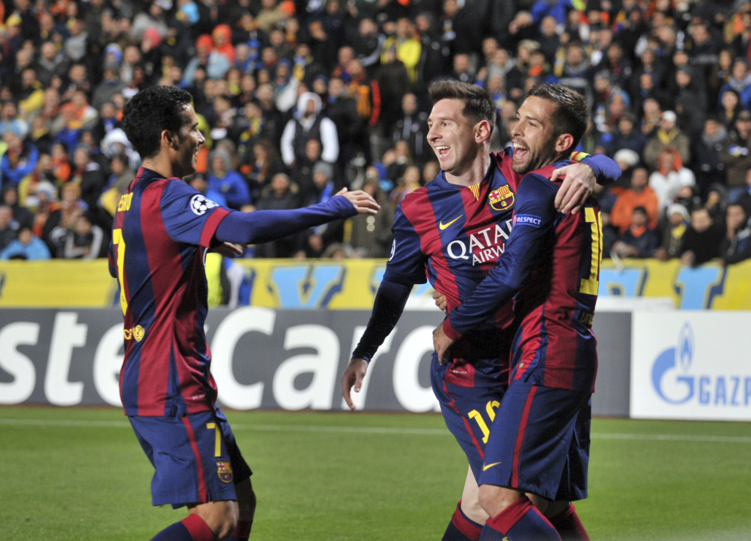 Lionel Messi celebrates with teammates after his record-breaking goal.