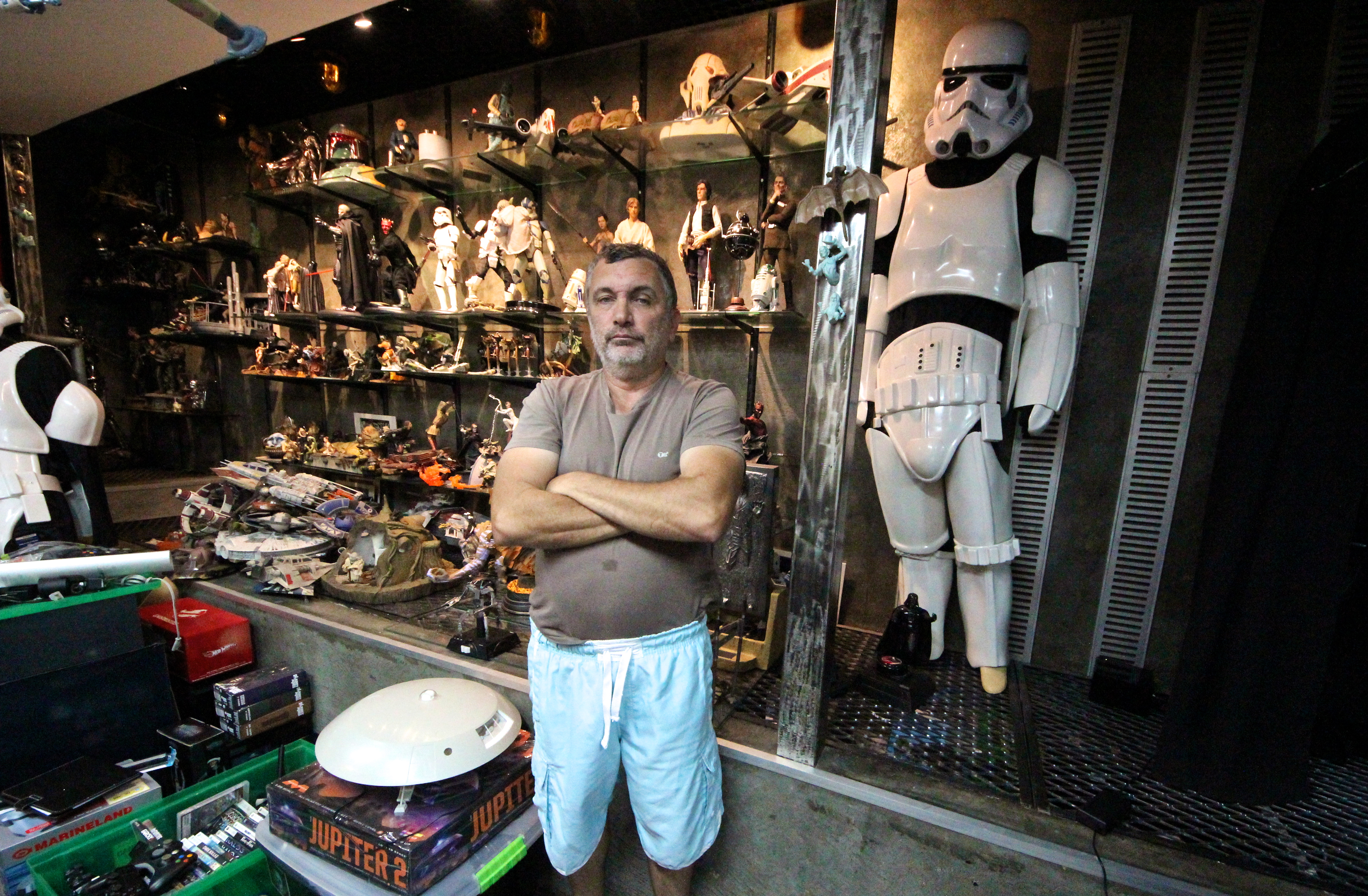 Biologist Mario Moscatelli poses with his collection of Star Wars memorabilia