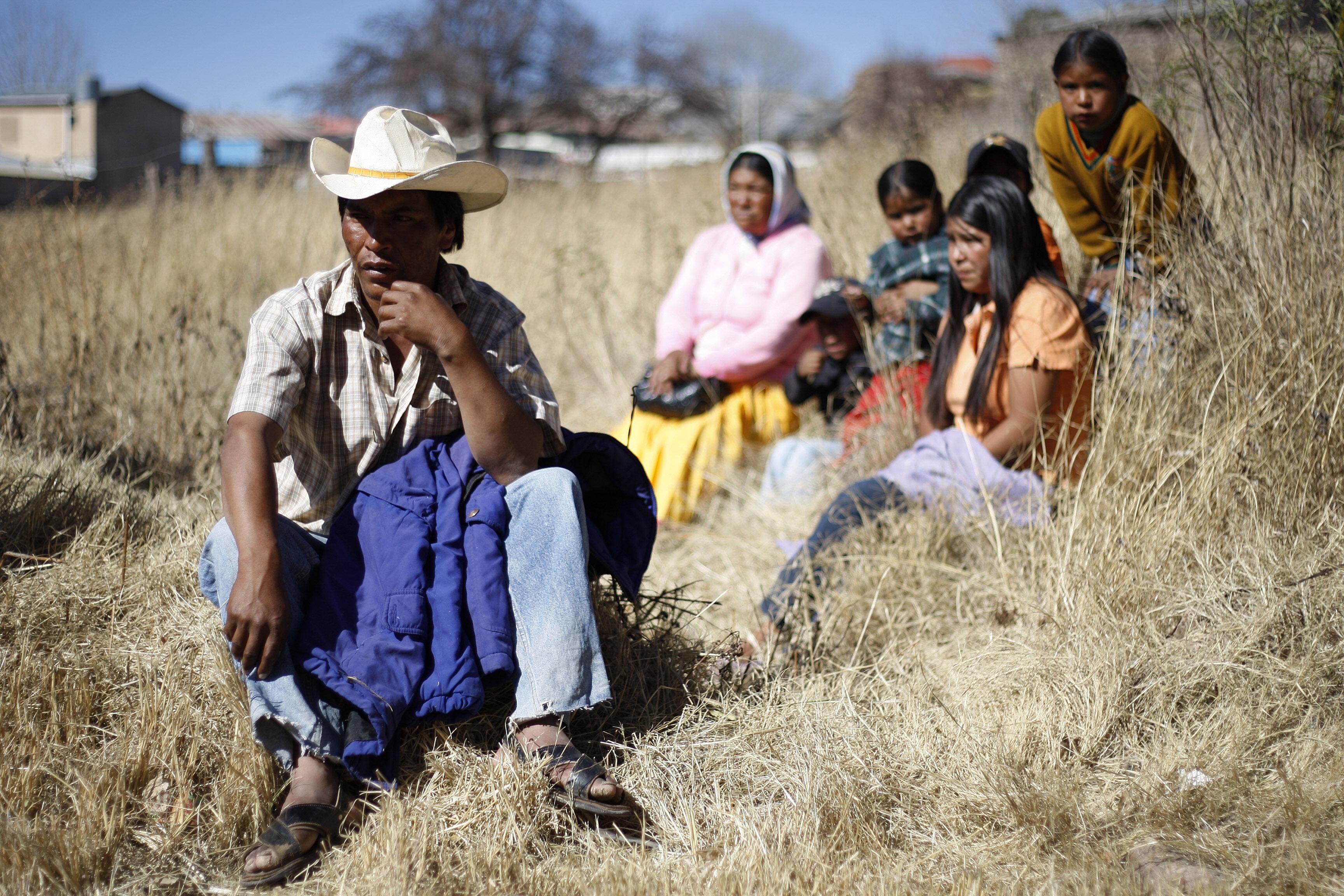 Tarahumara Indigenous family sits together in Guachochi November 30, 2011.