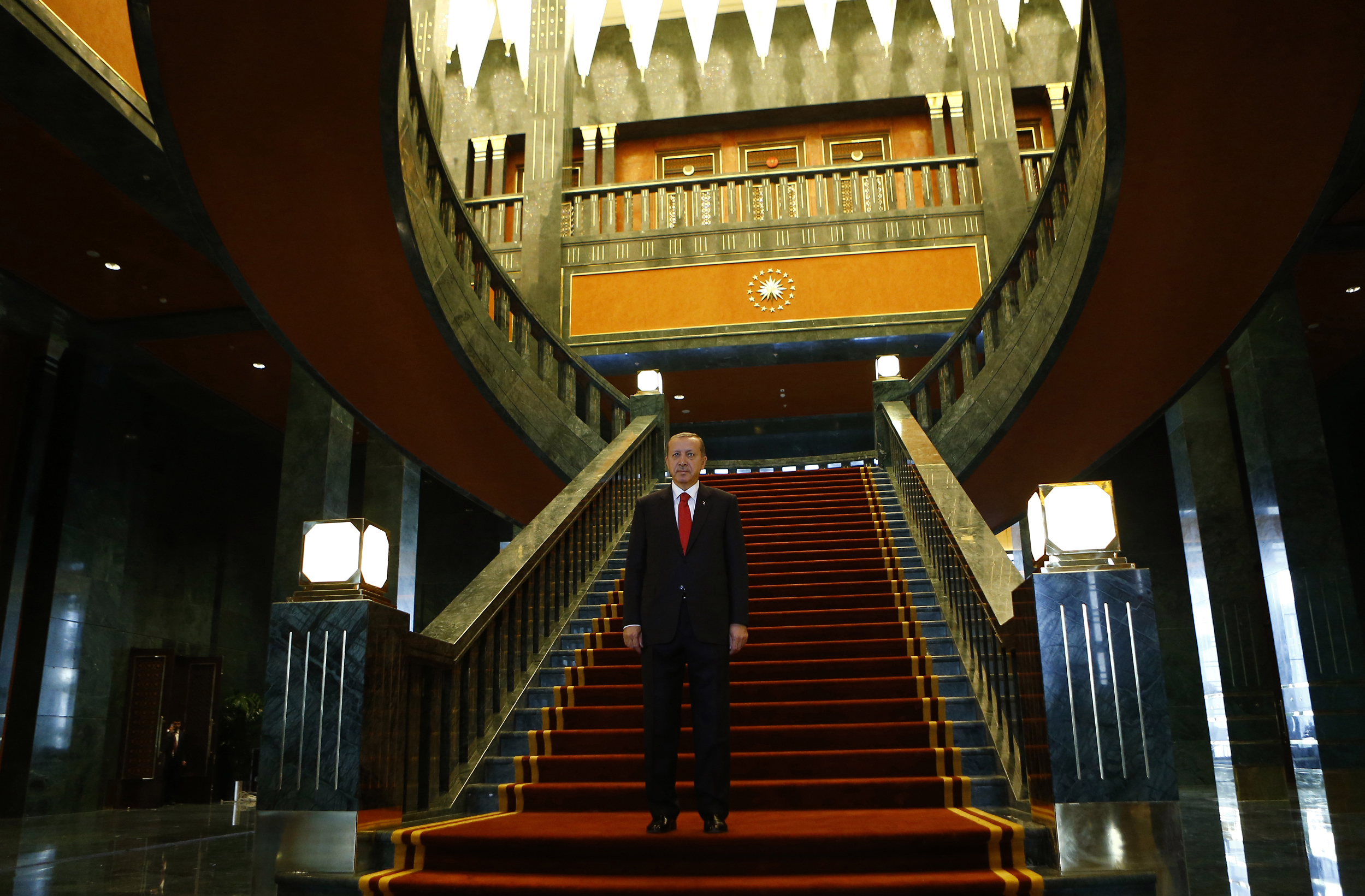 Turkey's President Tayyip Erdogan poses after an official ceremony to mark Republic Day at the new Presidential Palace in Ankara October 29, 2014.