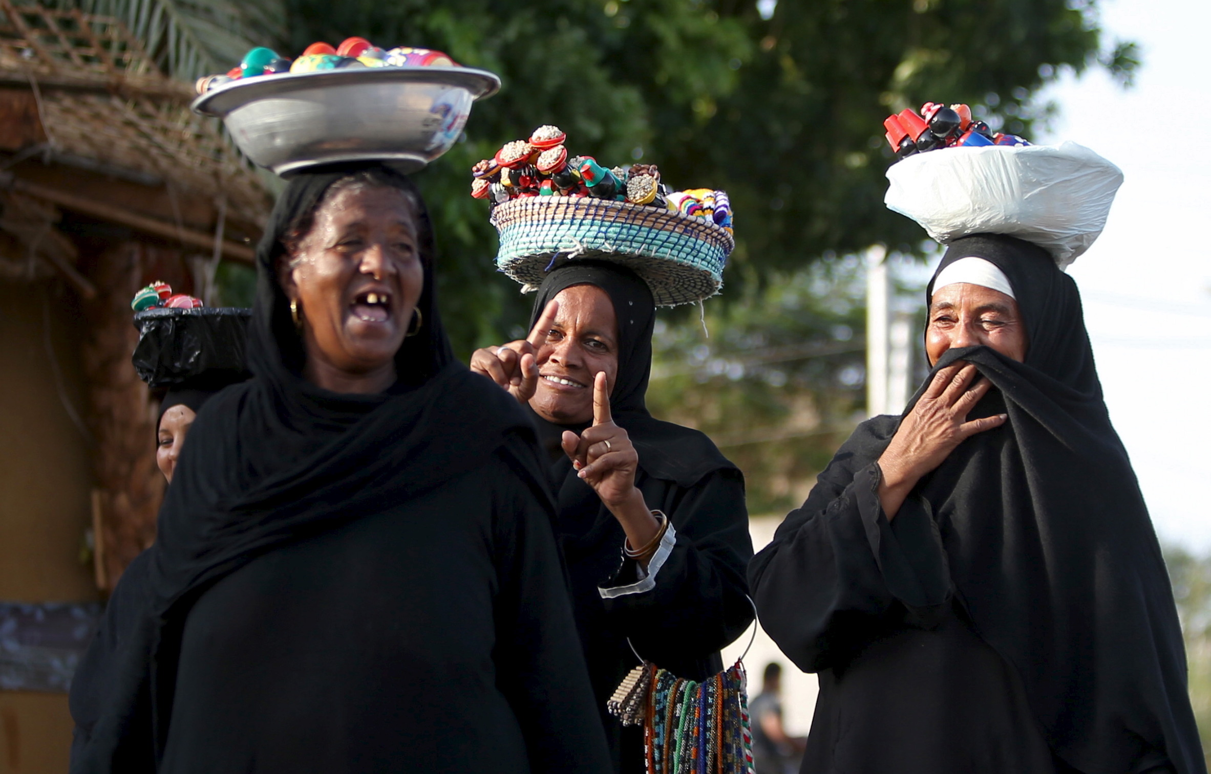 Nubian women sell traditional crafts at the Nubian Gharb Suheil village, near Aswan.