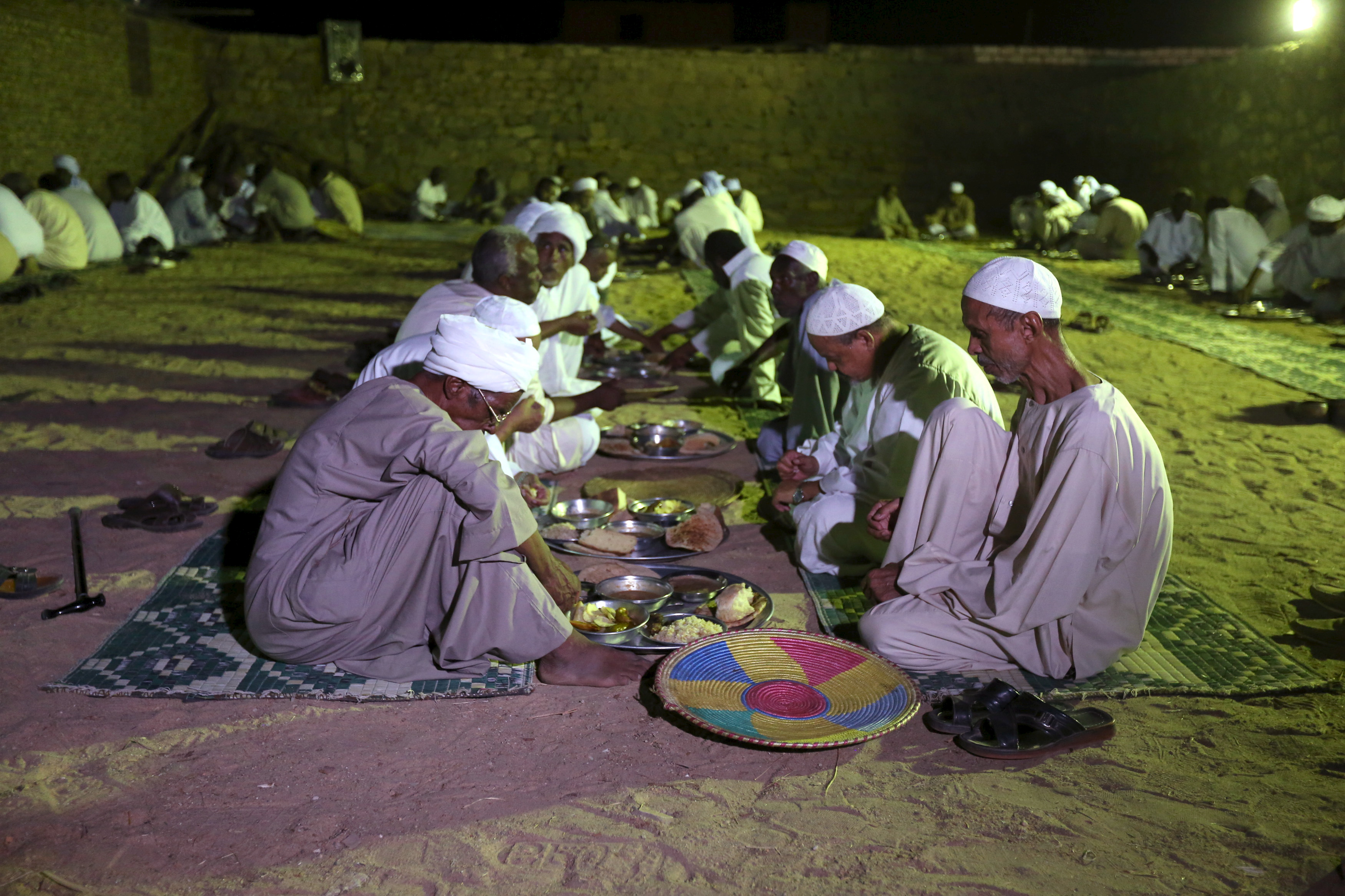 Invitees eat dinner as people celebrate a traditional Nubian wedding in the Nubian village of Adindan on Sept. 30, 2015.