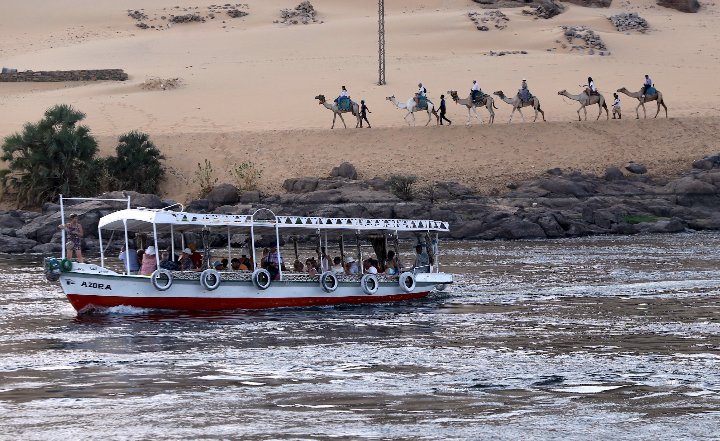 Tourists ride in a falluka (small boat) along the Nile river in Aswan on the way to Nubia, in southern Egypt.