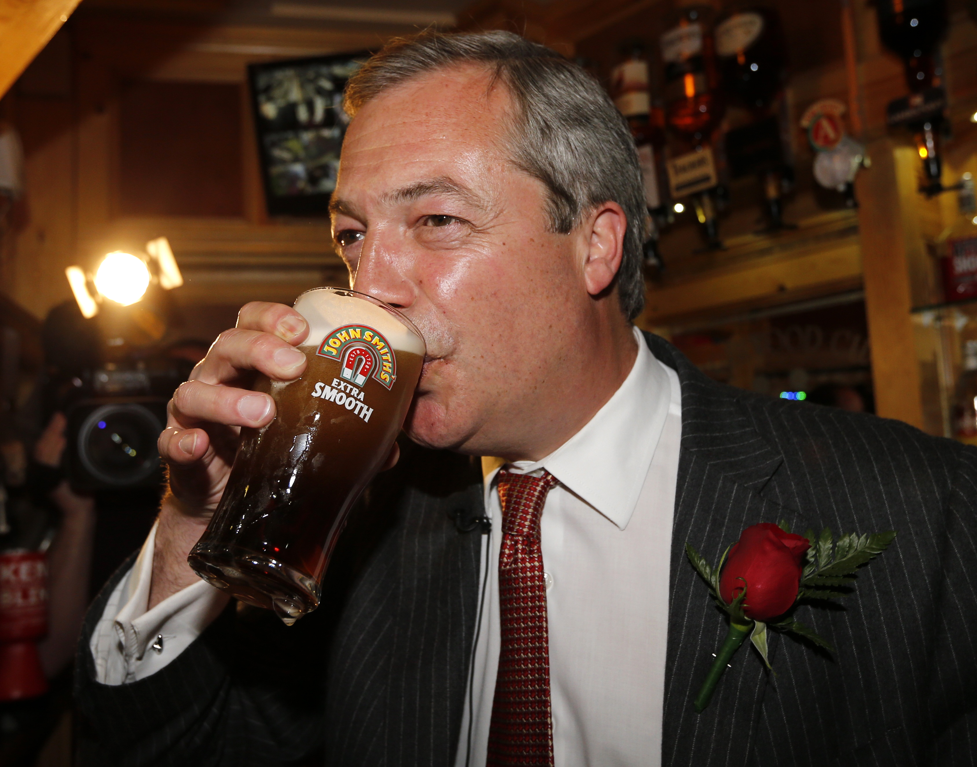United Kingdom Independence Party (UKIP) leader Nigel Farage enjoys a pint of beer during a visit to mark St George's day at the Northwood Club in Ramsgate, southern England, April 23, 2015
