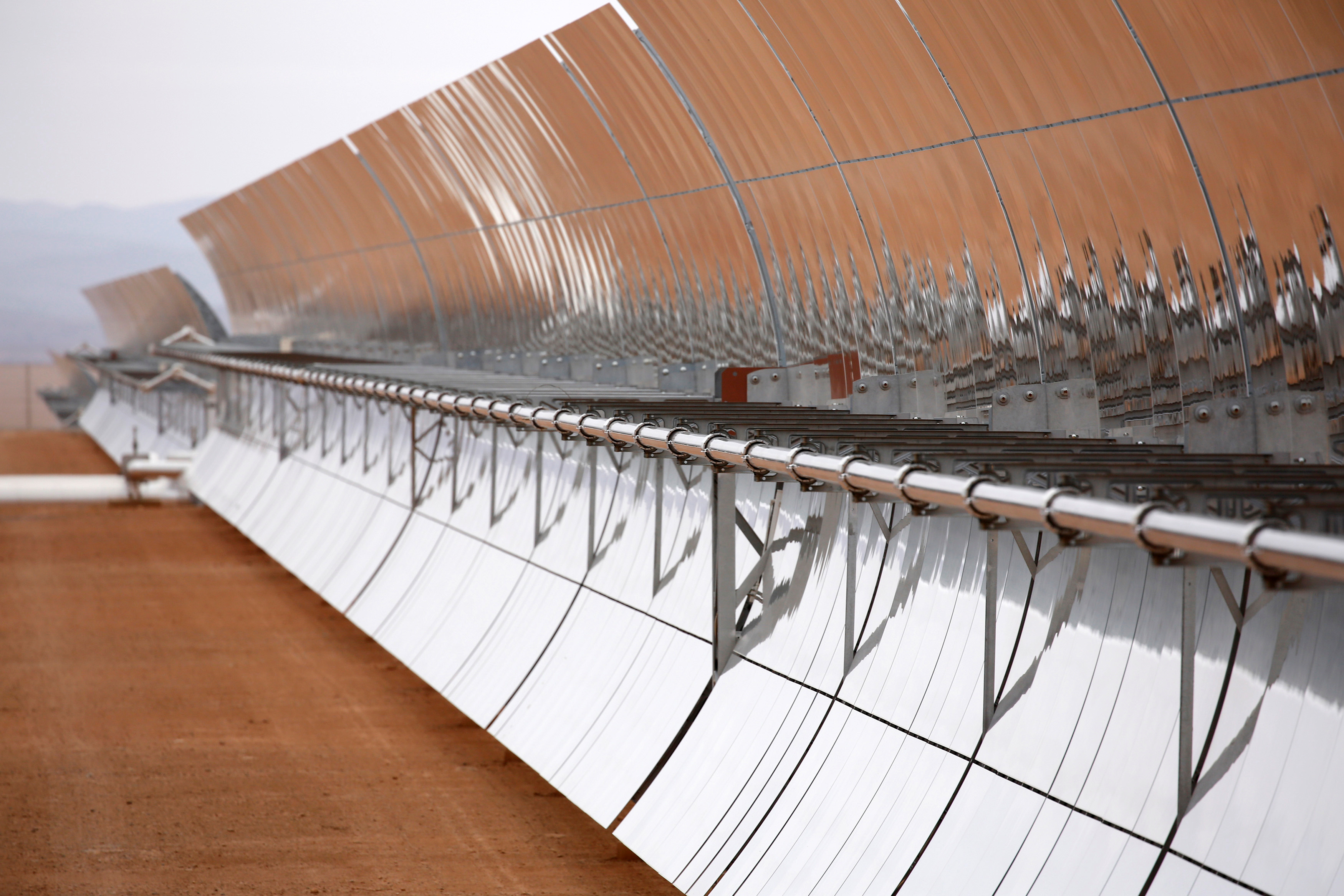 The concentrated solar power (CSP) technology at Morocco's NOOR plant uses thousands of curved mirrors like these to focus the sun's heat on tubes carrying a molten salt solution, heating the liquid up to roughly 700 degrees Fahrenheit. That heat is then