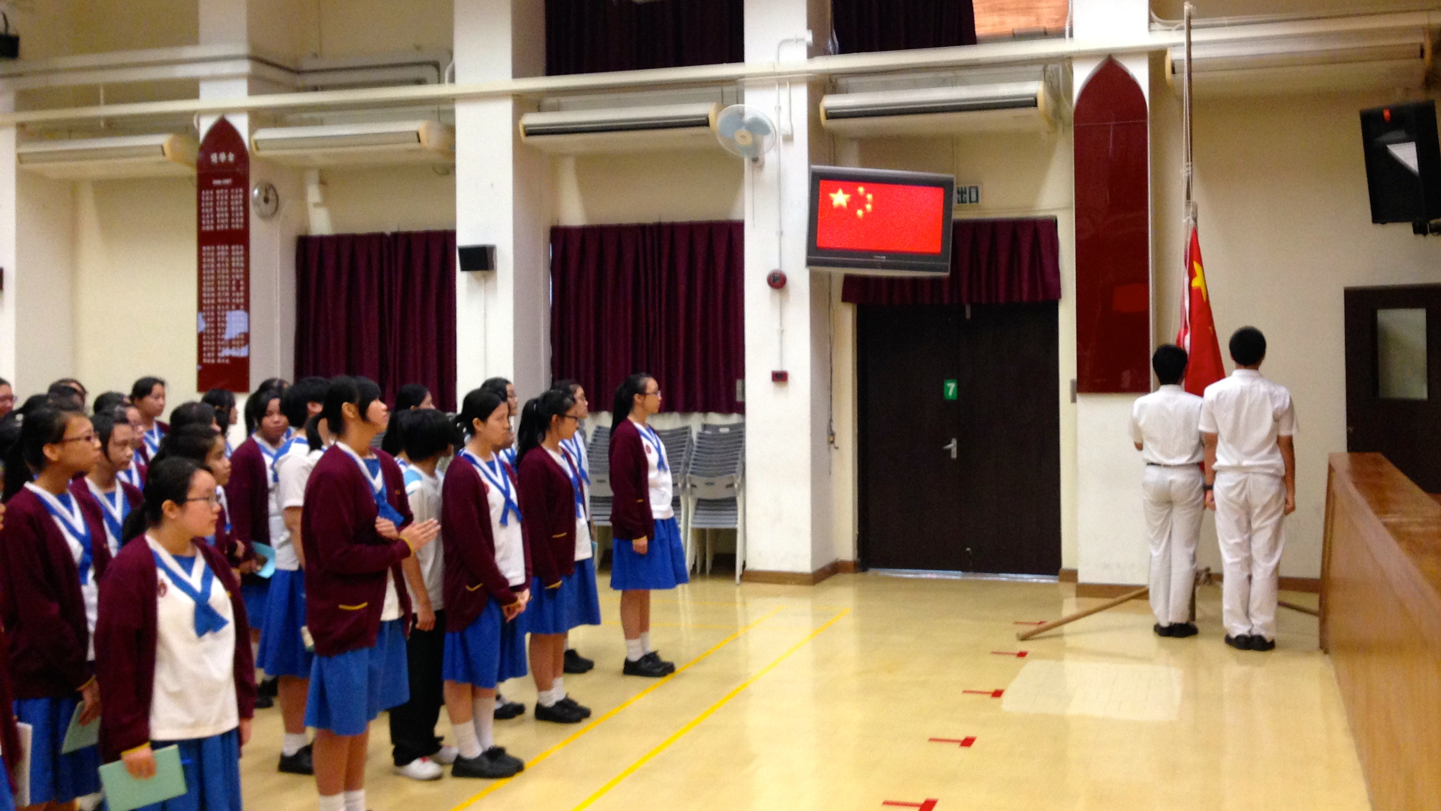 Middle school students at Lee Kau Yan Memorial School participate in a flag-raising ceremony.