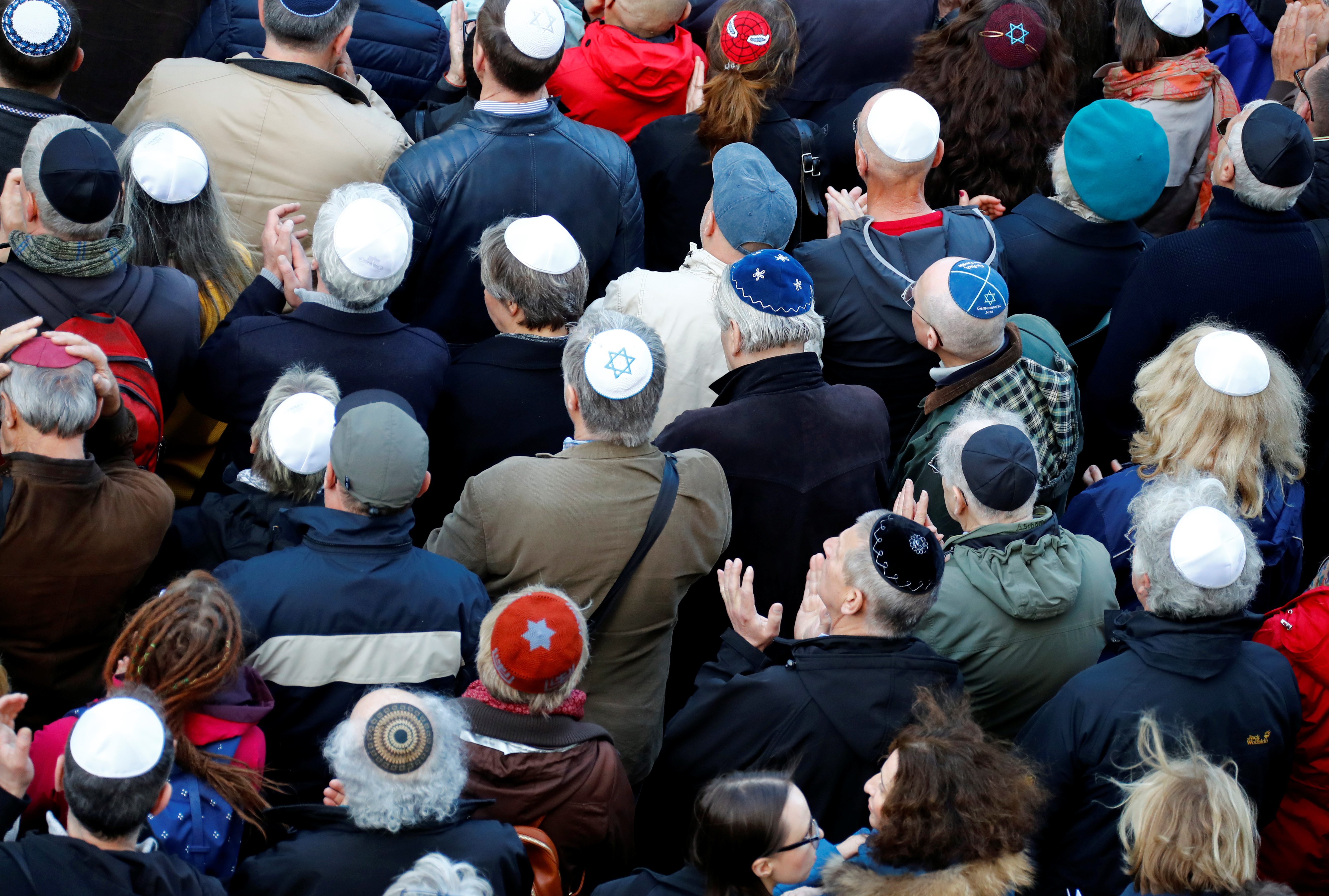 People from different faiths wear kippas as they attend a demonstration on April 25th in front of a Jewish synagogue, to denounce an anti-Semitic attack on a young man wearing a kippa in Berlin earlier in the month.