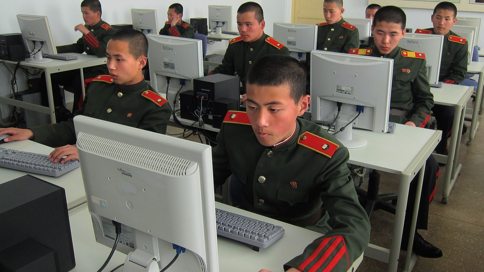 Rows of students at Mangyongdae Revolutionary School, a prestigious academy in Pyongyang, sit at computers.
