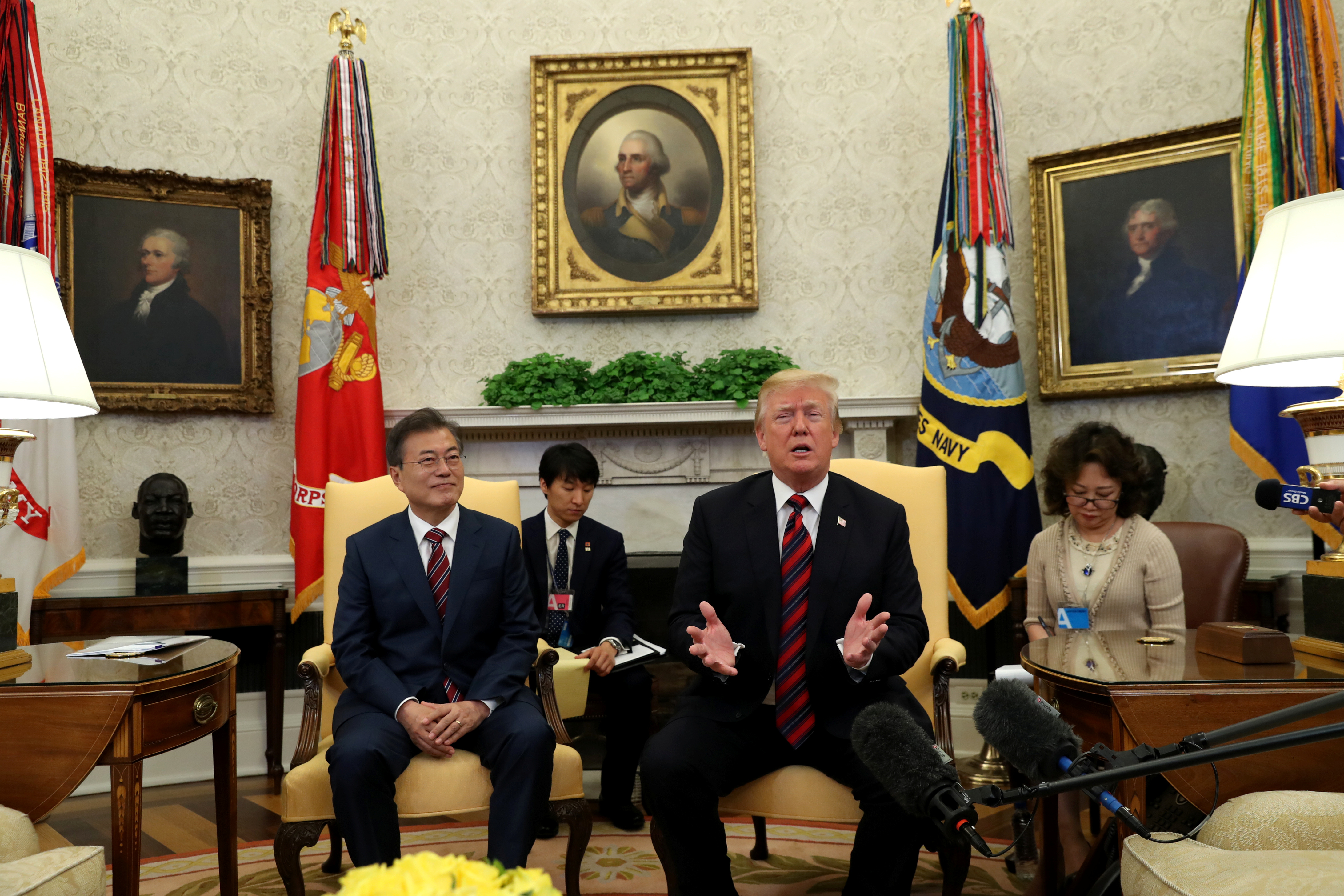 US President Donald Trump sits beside South Korea's President Moon Jae-In in the Oval Office of the White House in Washington, DC, May 22, 2018.