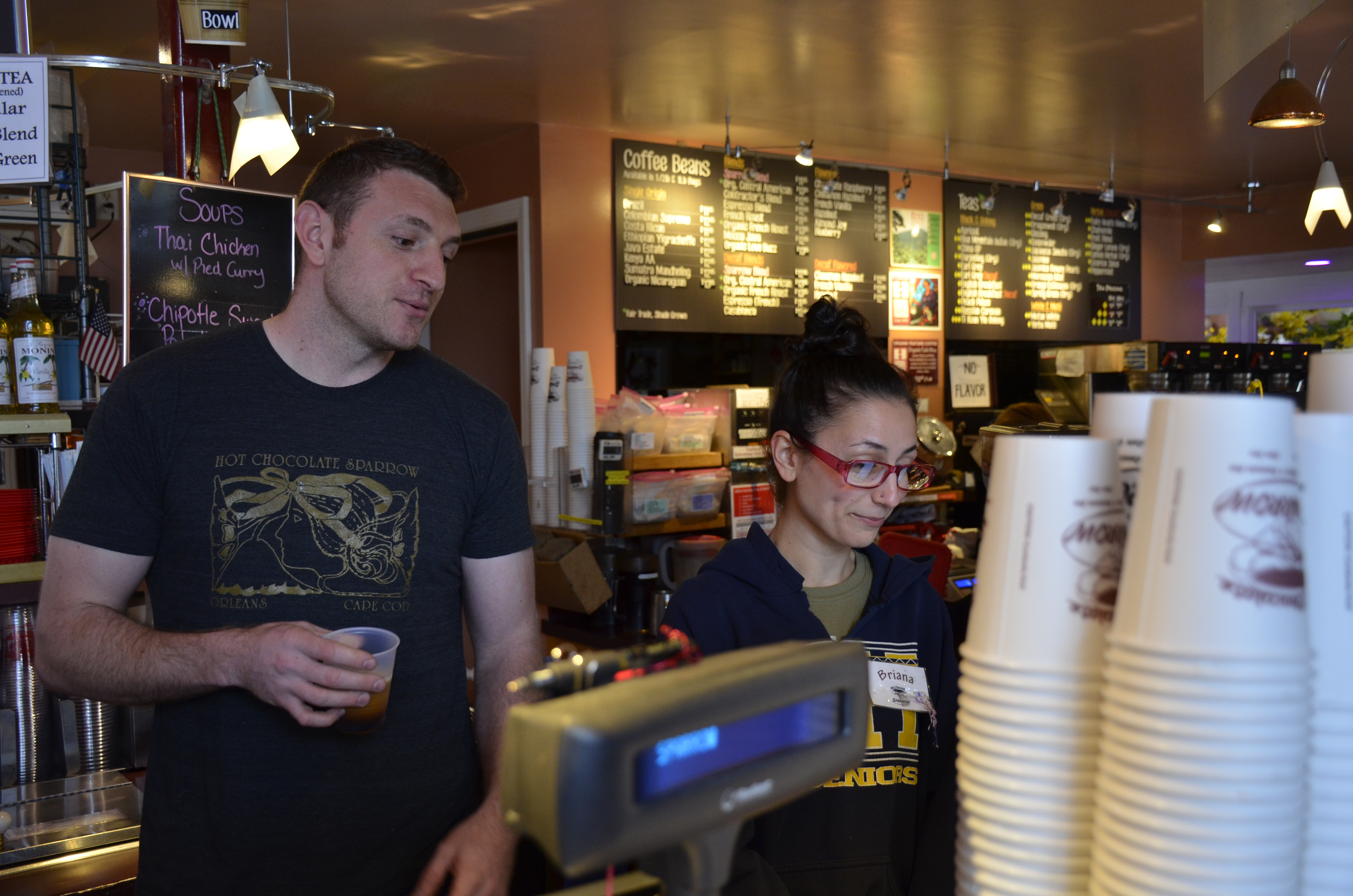 Perry Sparrow (left) and his employee Briana Trafuoci behind the counter at the Hot Chocolate Sparrow. In part due to the high cost of housing on the Cape, Sparrow says there's not enough local seasonal workers to hire.