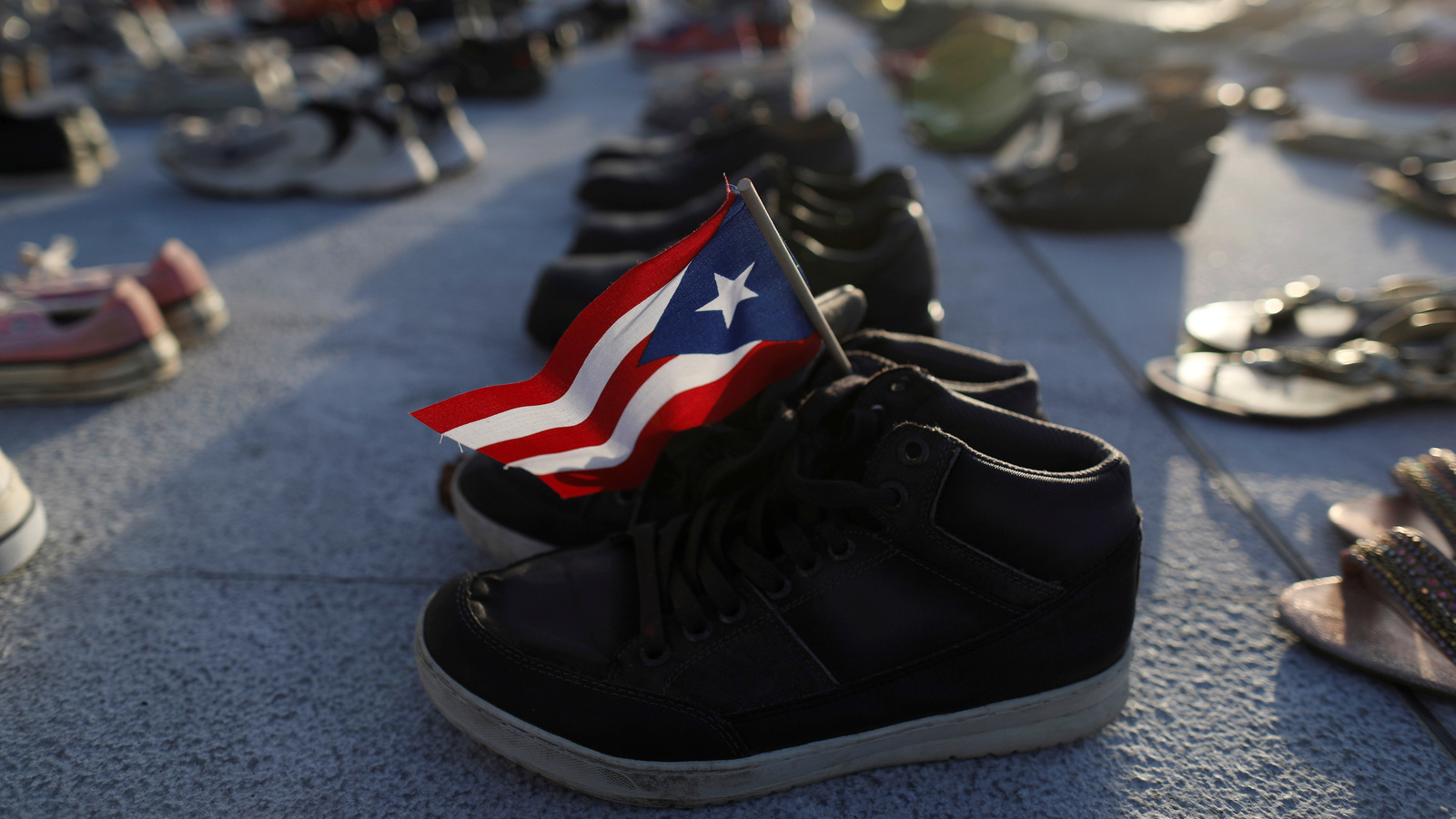 Shoes at Puerto Rico's capitol building represent the more 4,645 deaths attributed to Hurricane Maria