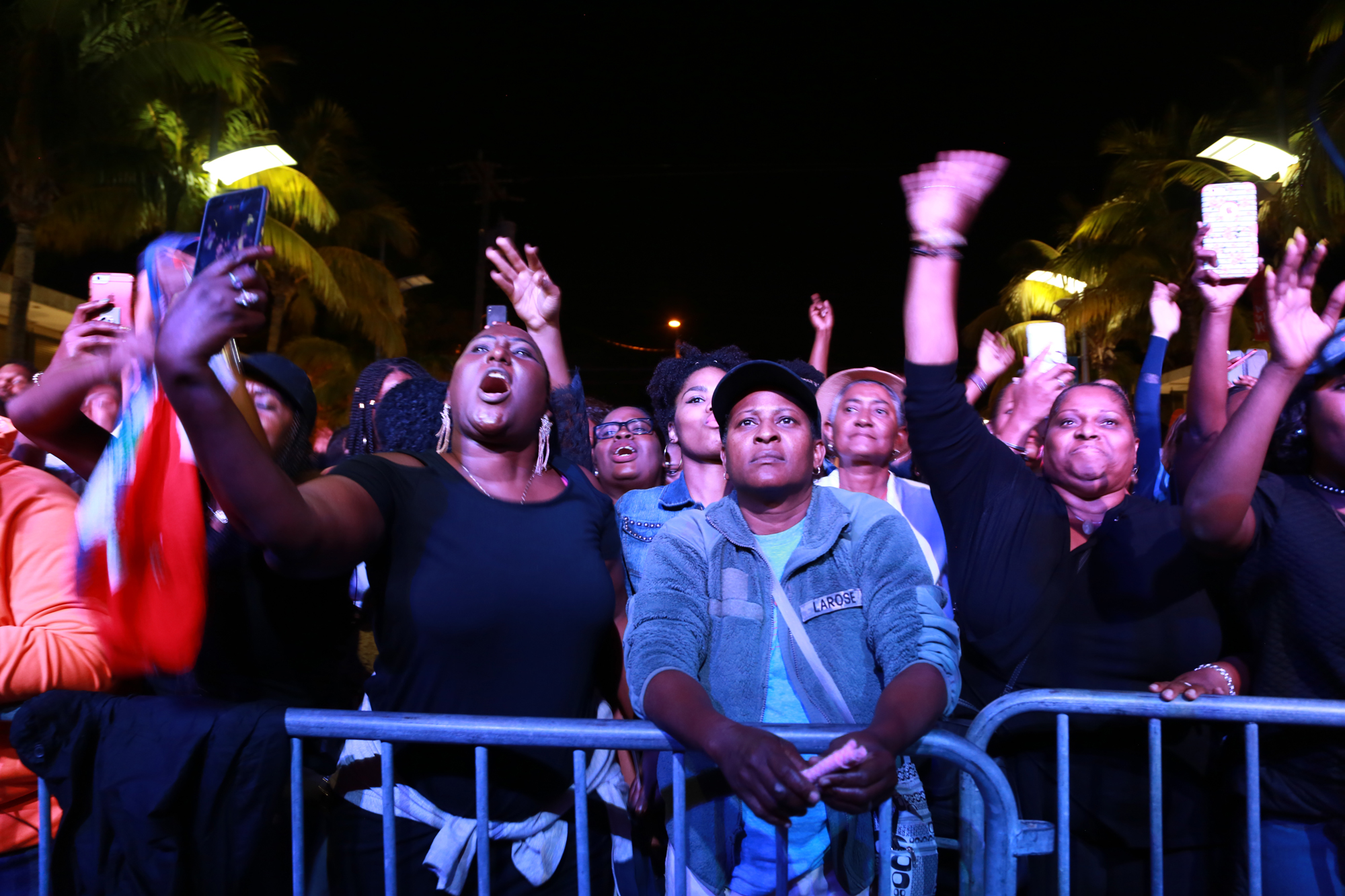 People in the crowd in Miami, Florida dance during a set at the Bayo Block Party.