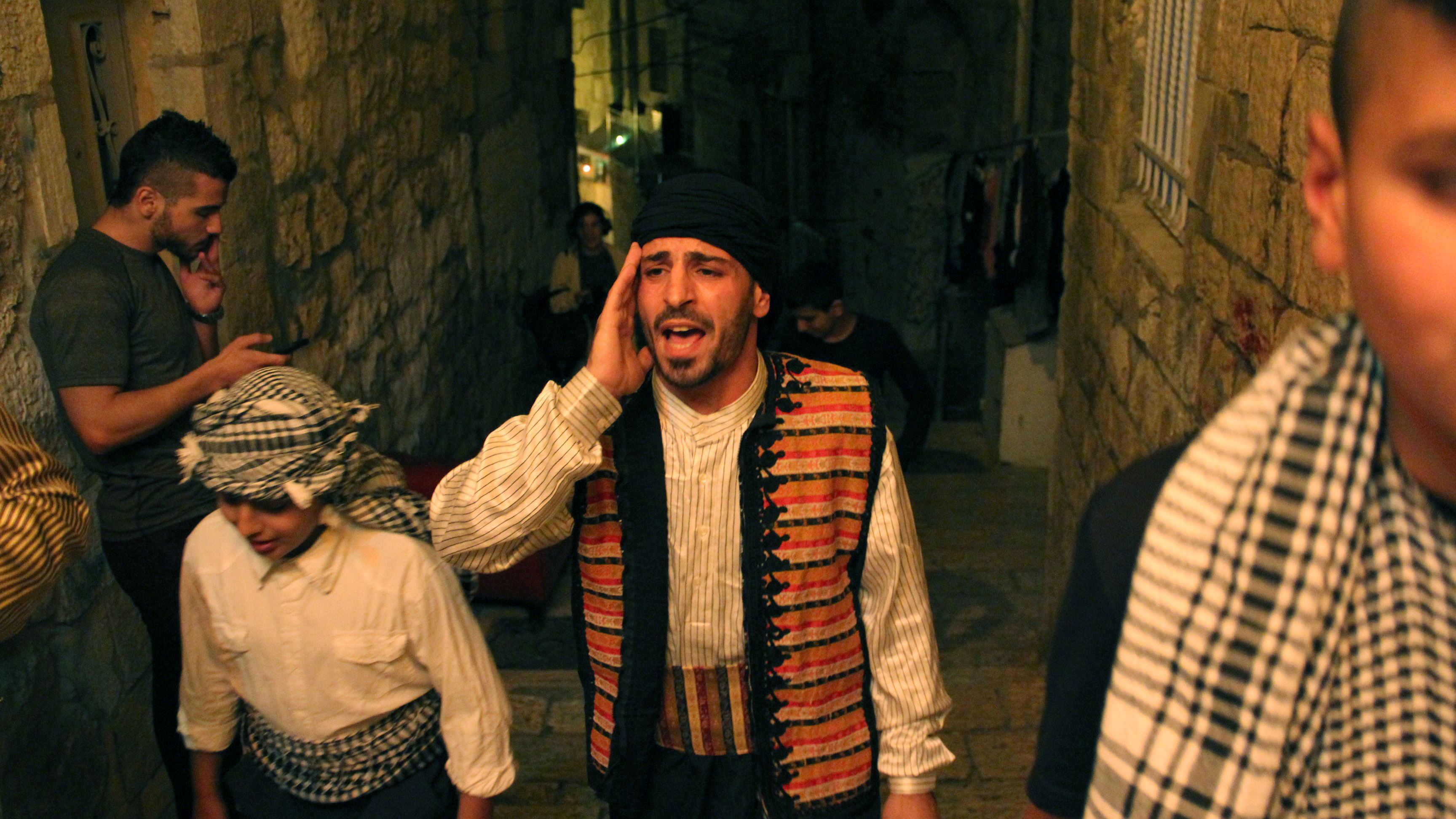 three young men in old city jerusalem