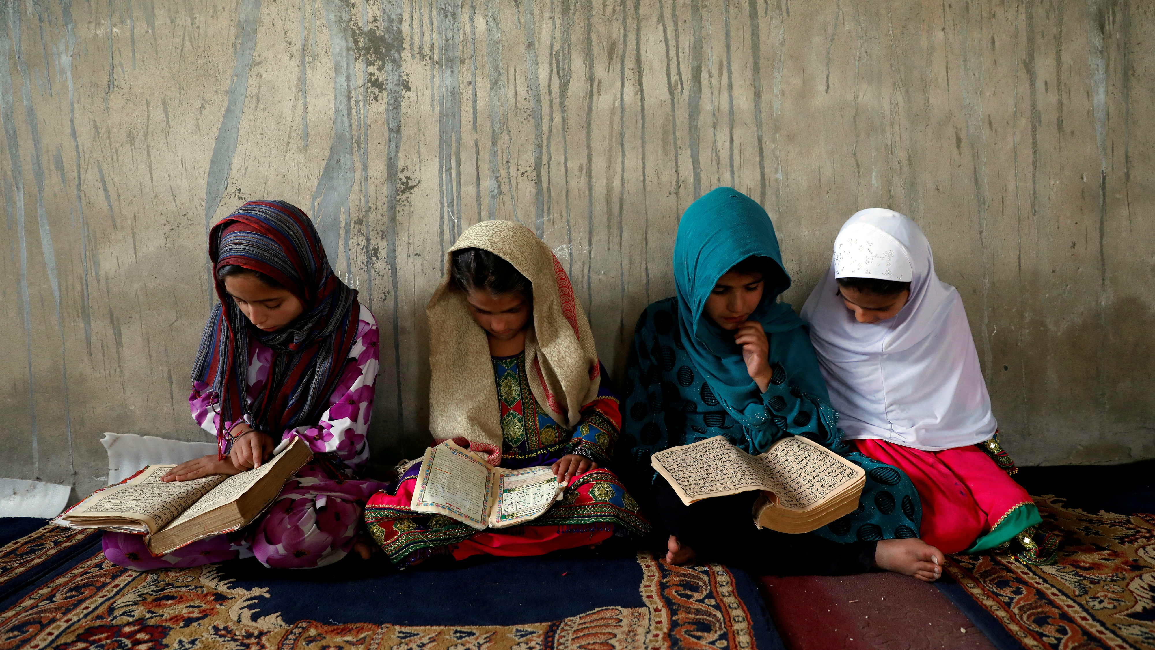 Afghan girls read the Quran in a religious school in Kabul, Afghanistan, May 28, 2018. Humanitarian organizations say 3.7 million children (44 percent) in Afghanistan are out of school — 2.7 million of them are girls.