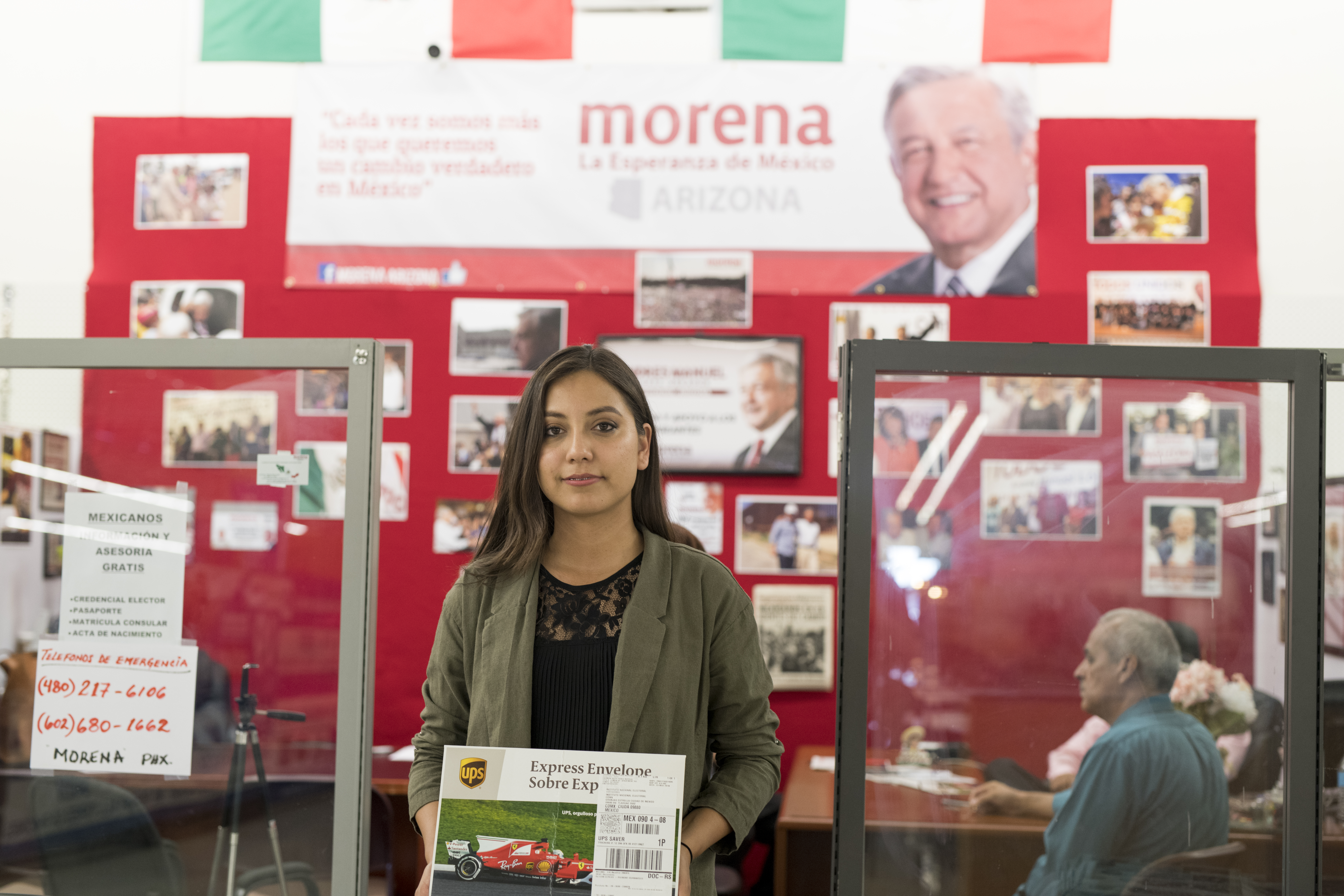 Carmen Pérez Noyola, holding an envelope, prepares to mail in her ballot from Phoenix for the July 1 presidential election in Mexico.