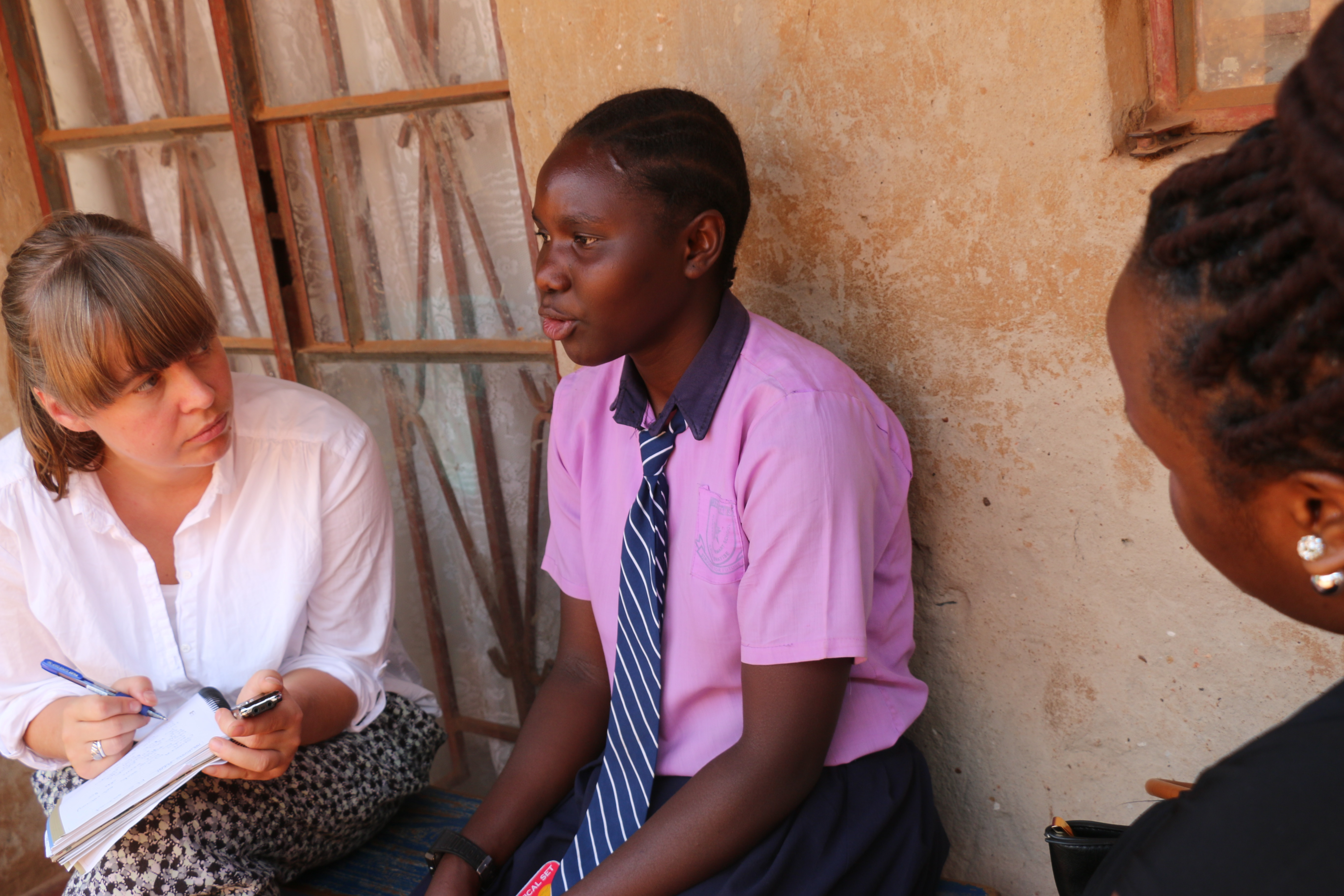 Author Anna Dahlqvist talking with Saudah, a teenager in Kampala, Uganda