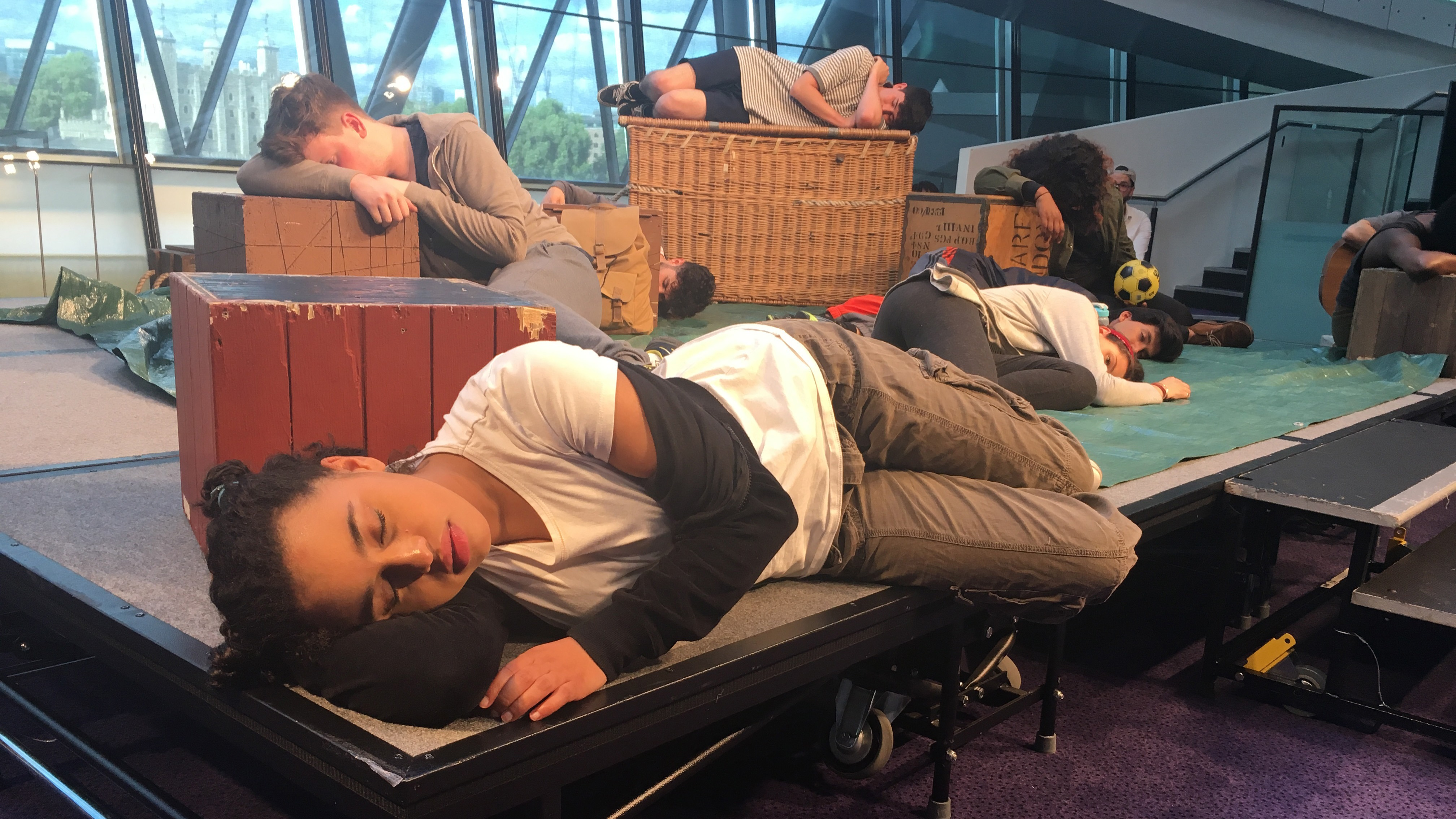 """Yusra, played by Rhianna Merralls, struggles to fall asleep in the play, """"Wherever I Lay My Head,"""" performed in London City Hall."""
