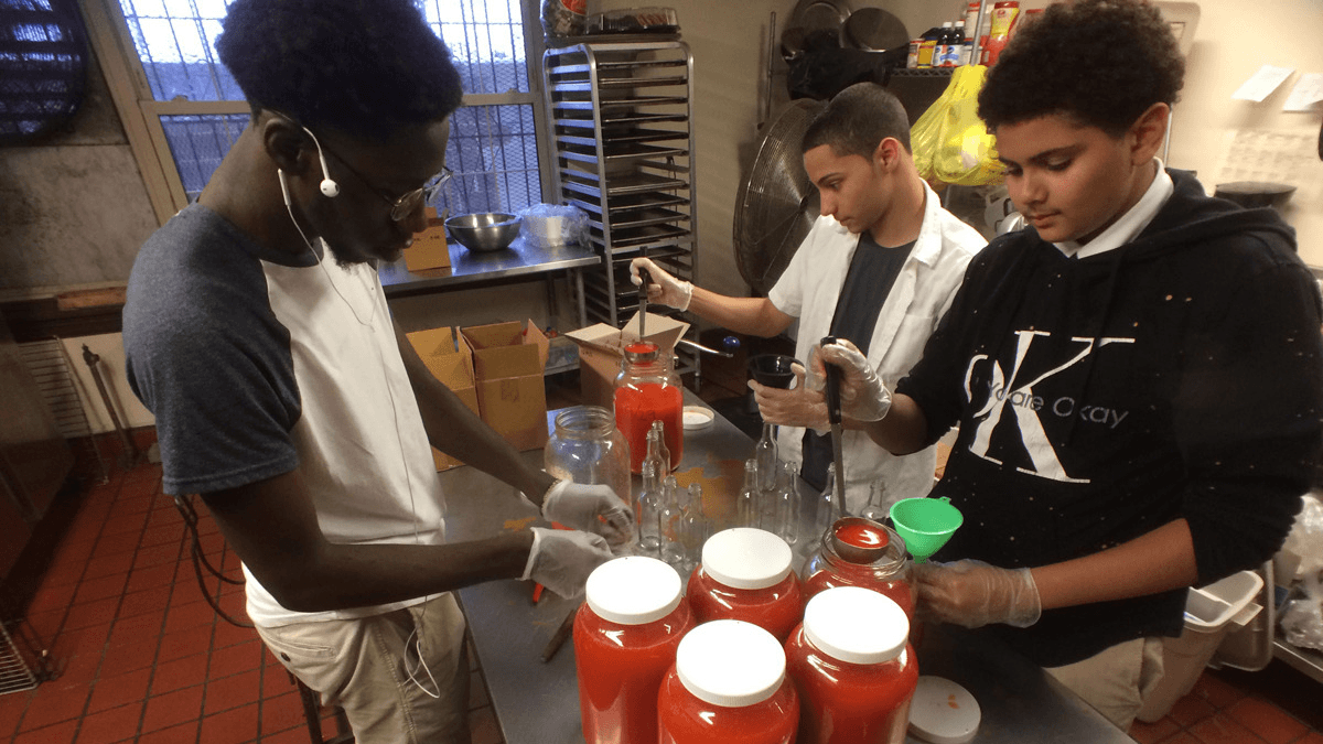 young adults make hot sauce