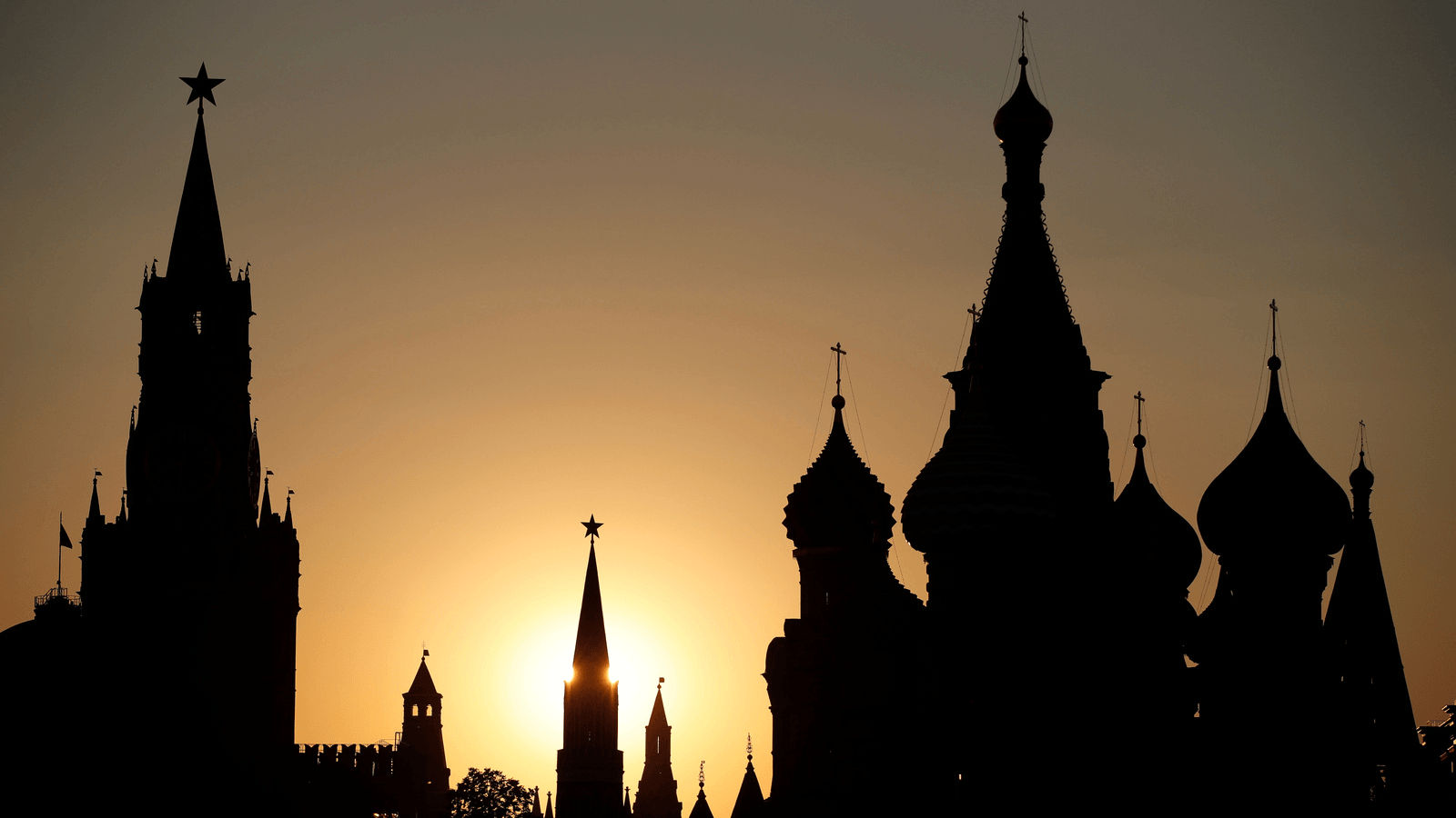 a profile view of the Kremlin in Moscow at sunset