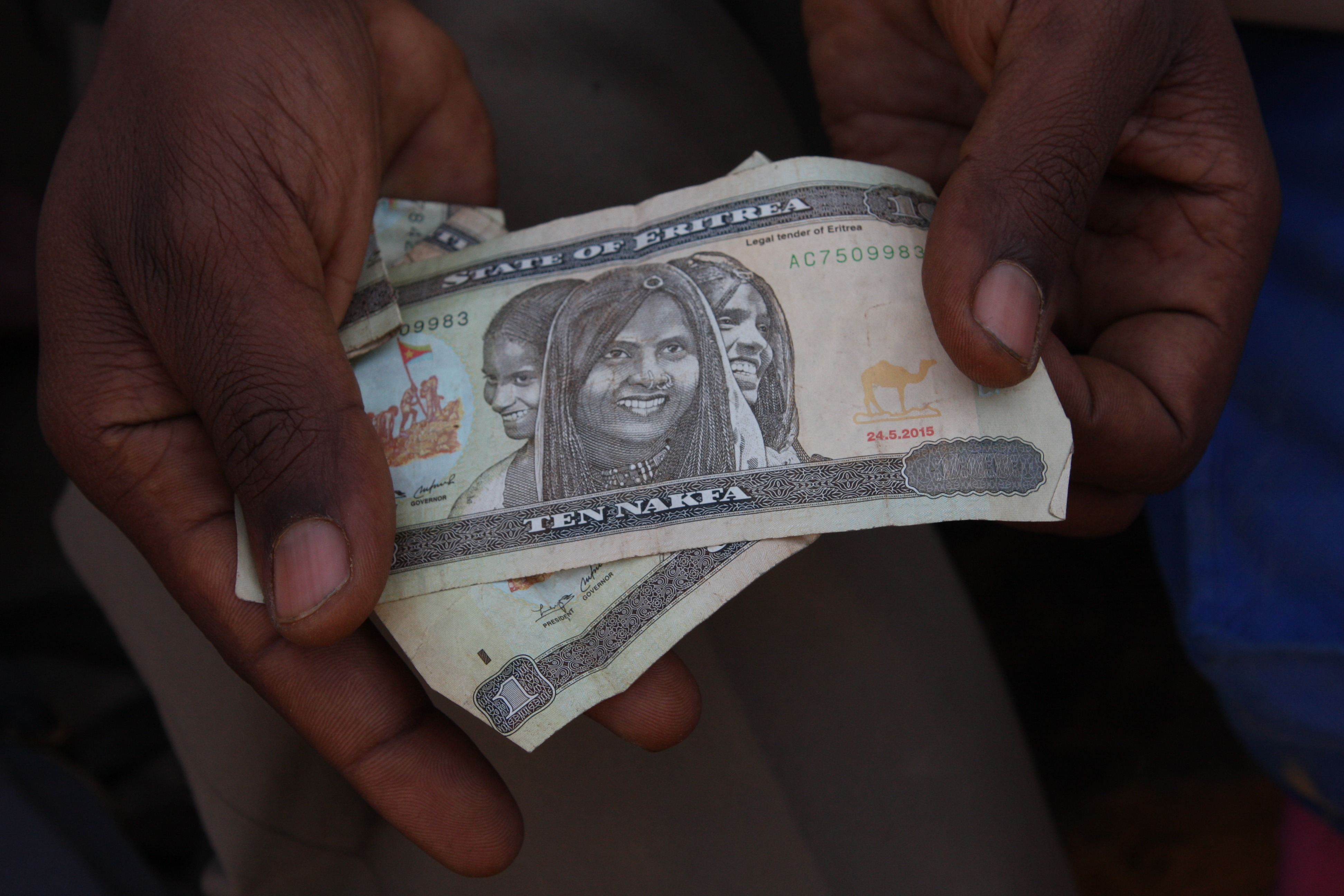 small wad of money from an eritrean man at the border