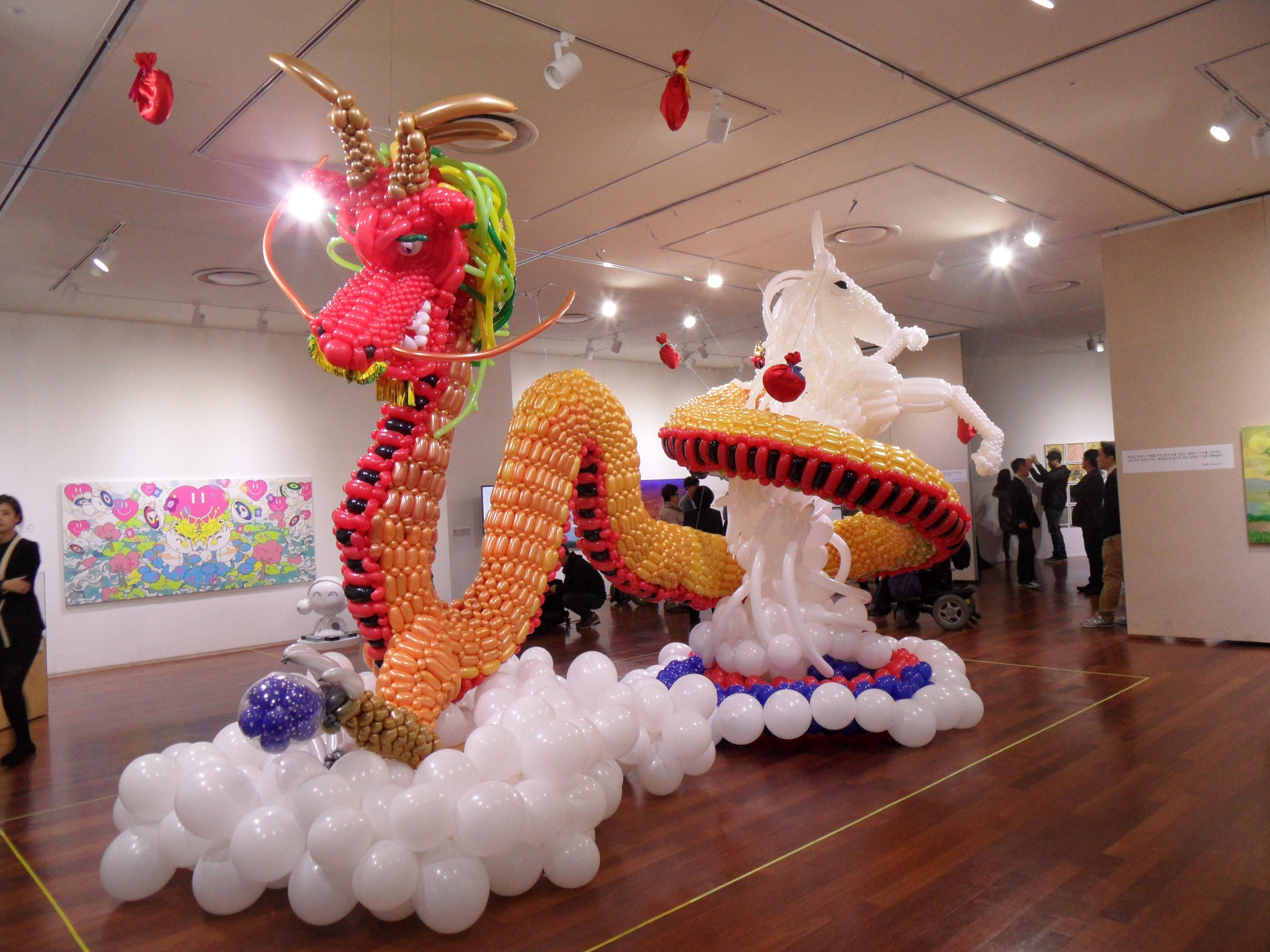 a balloon sculpture of a dragon and unicorn