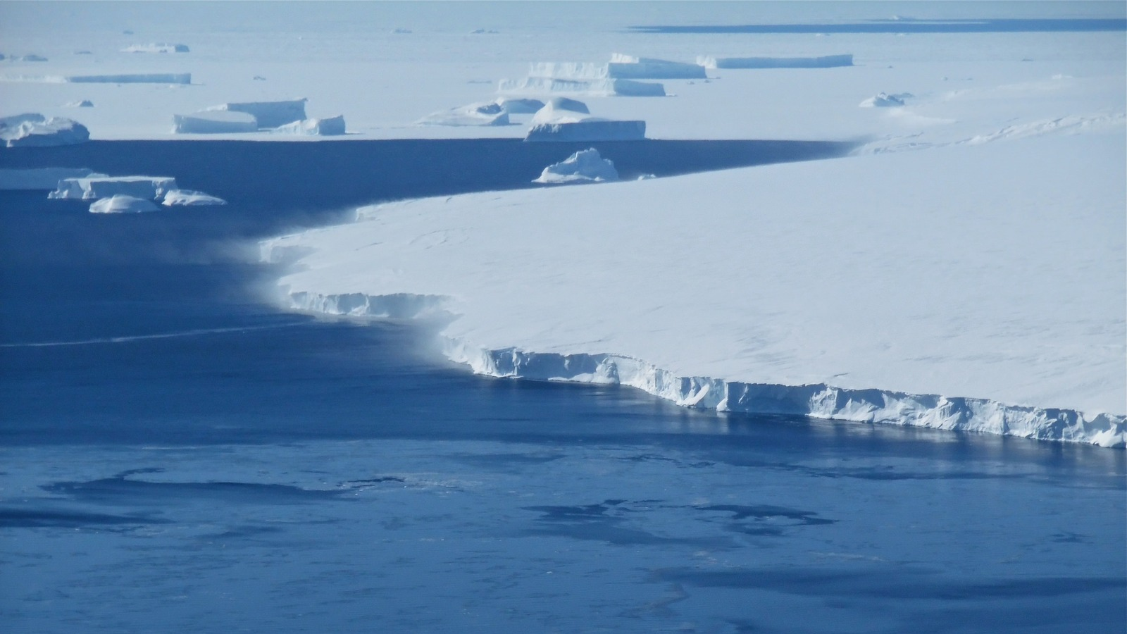 Snow is blown off of the calving front off of Thurston Island in western Antarctica in this photo, taken in November 2014. New findings show the western side of Antarctica to be more vulnerable to warming oceans — and increased ice loss — than first thoug