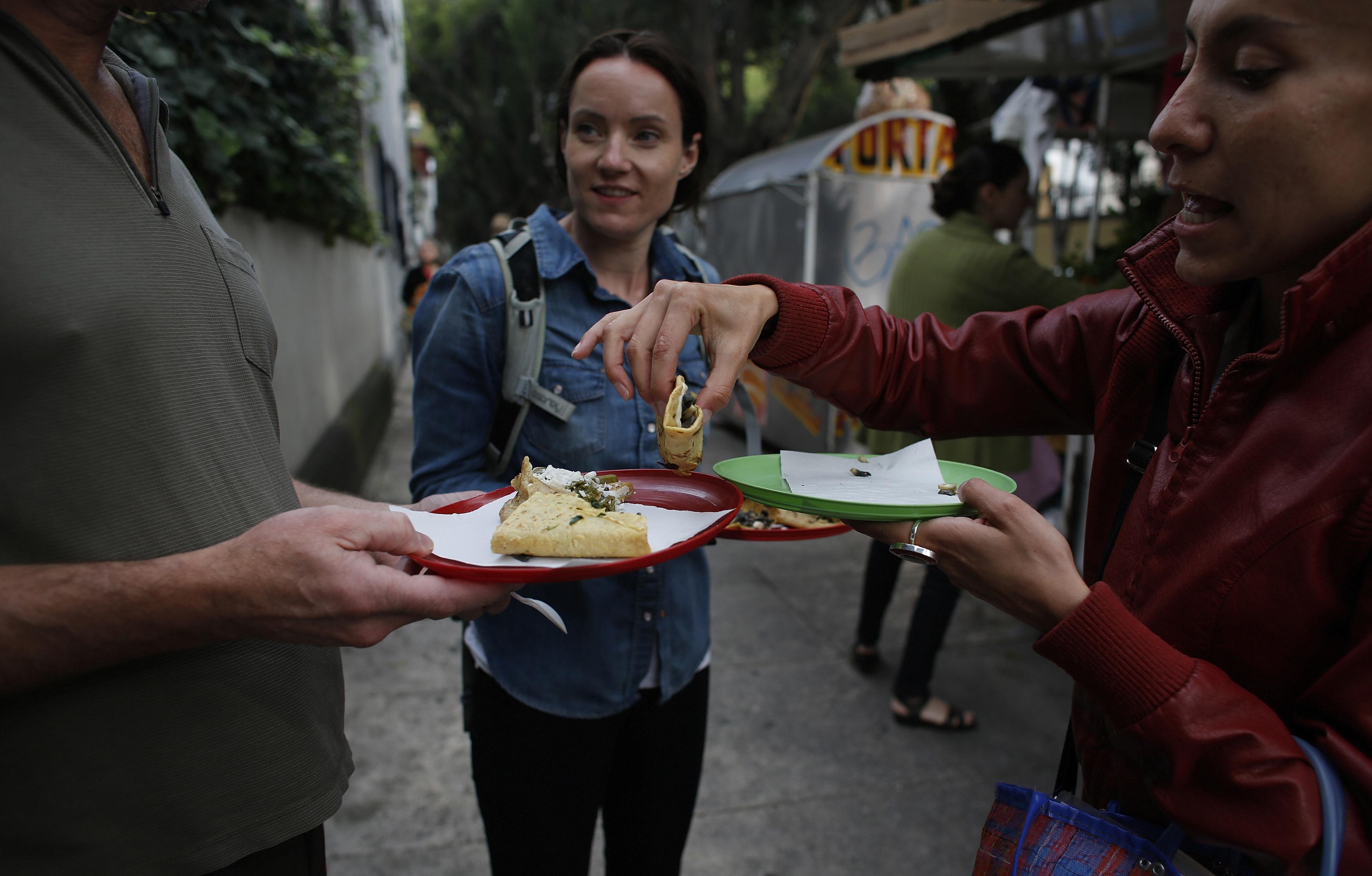 three people split quesadillas