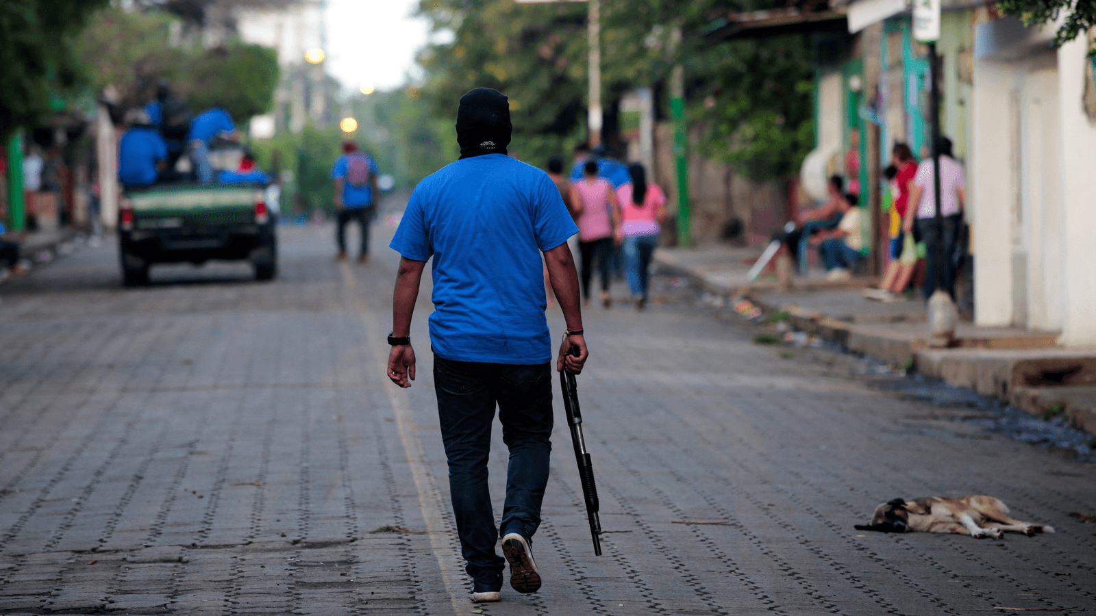 armed  government paramilitary man in the streets of Nicaragua