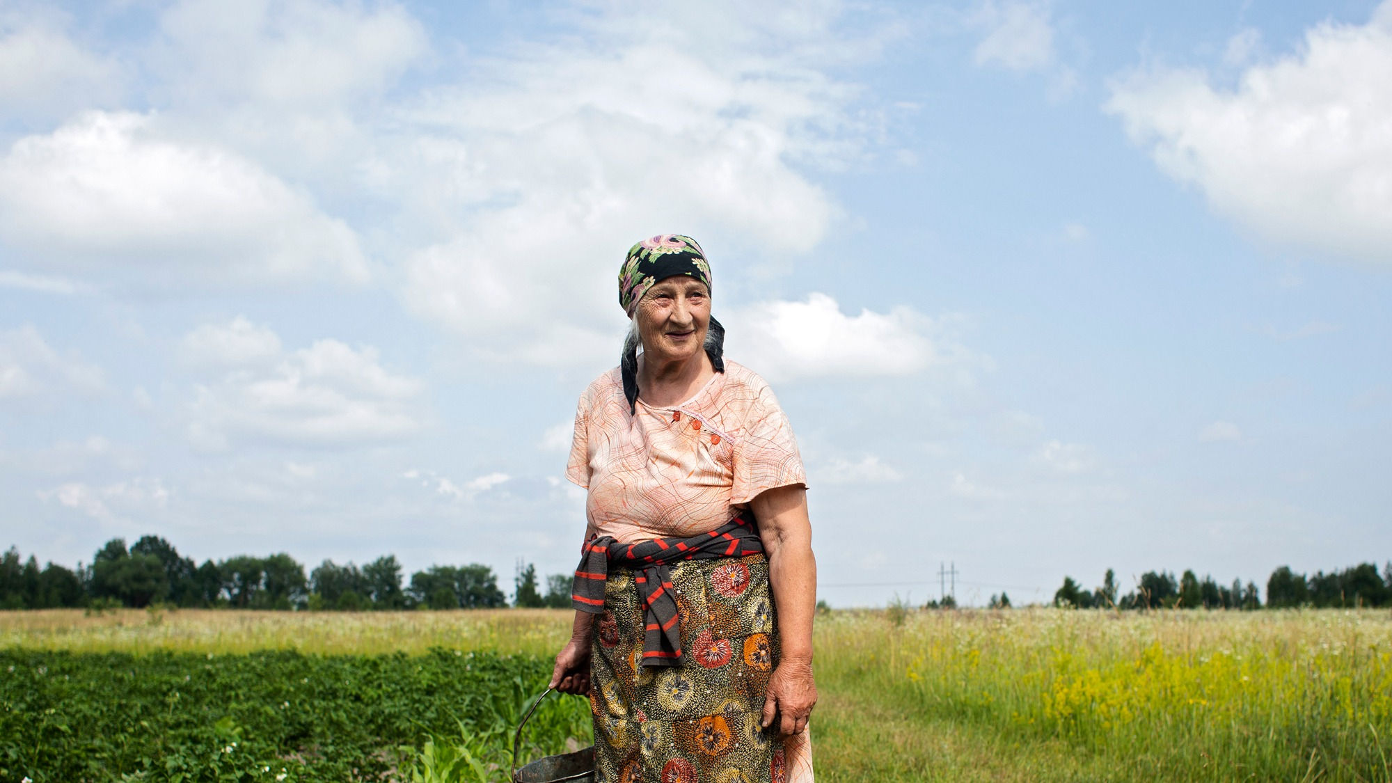 and old woman in a field