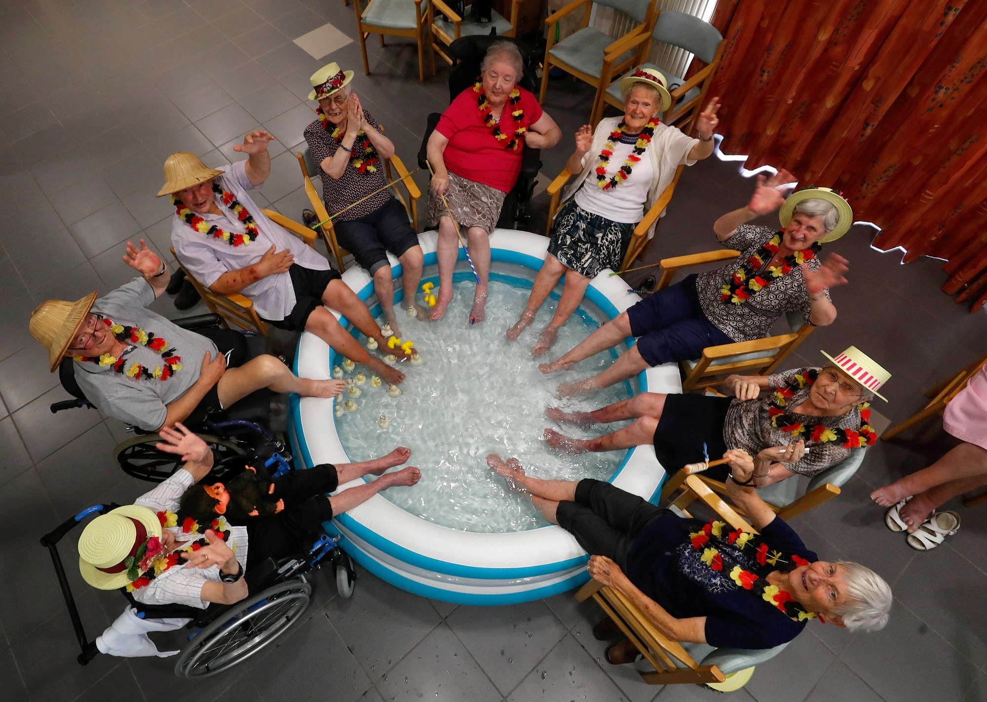 Residents at the Ter Biest house for elderly persons refresh their feet in a pool in this over-head photograph.