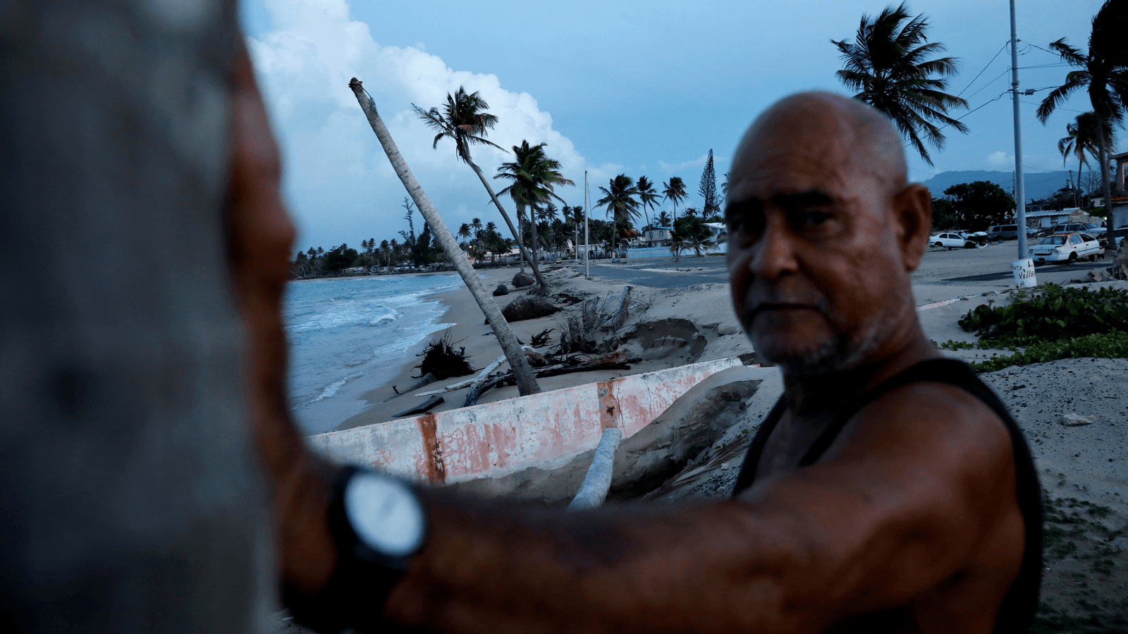 a man on a battered beach in puerto rico