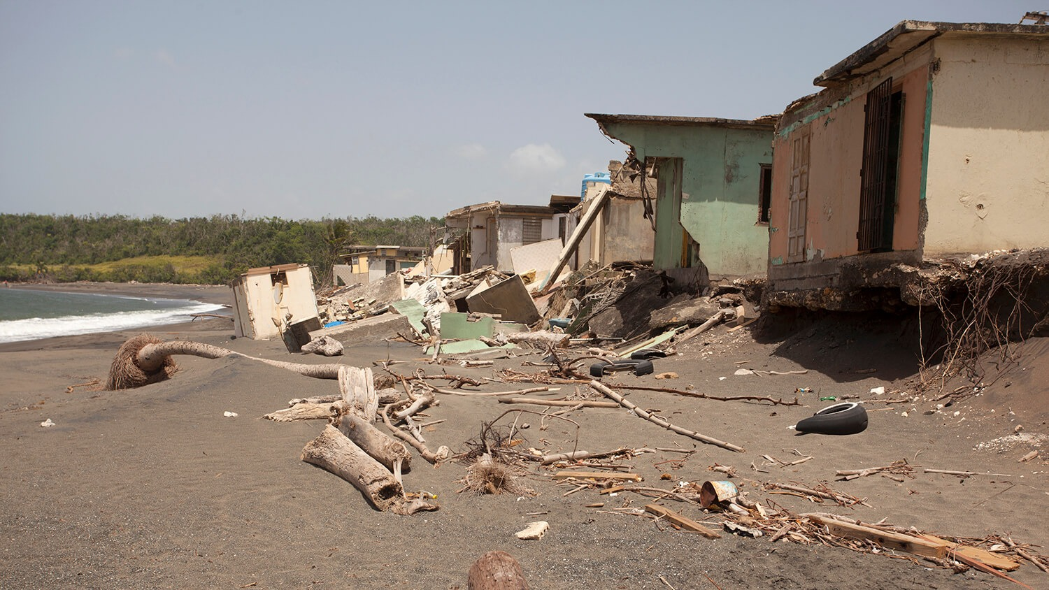 Destroyed homes on a beach