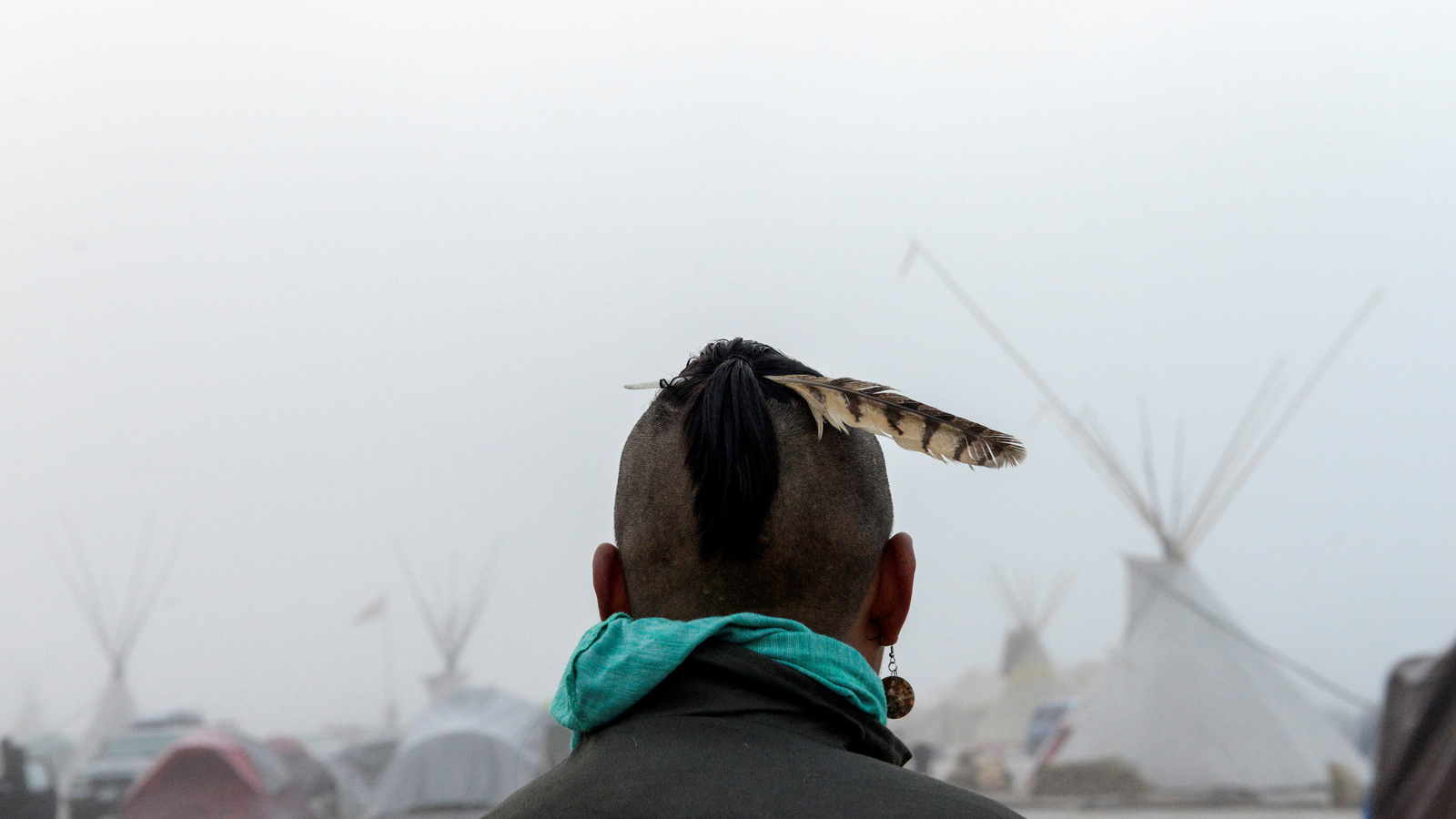 a man stands at near Standing Rock North Dakota