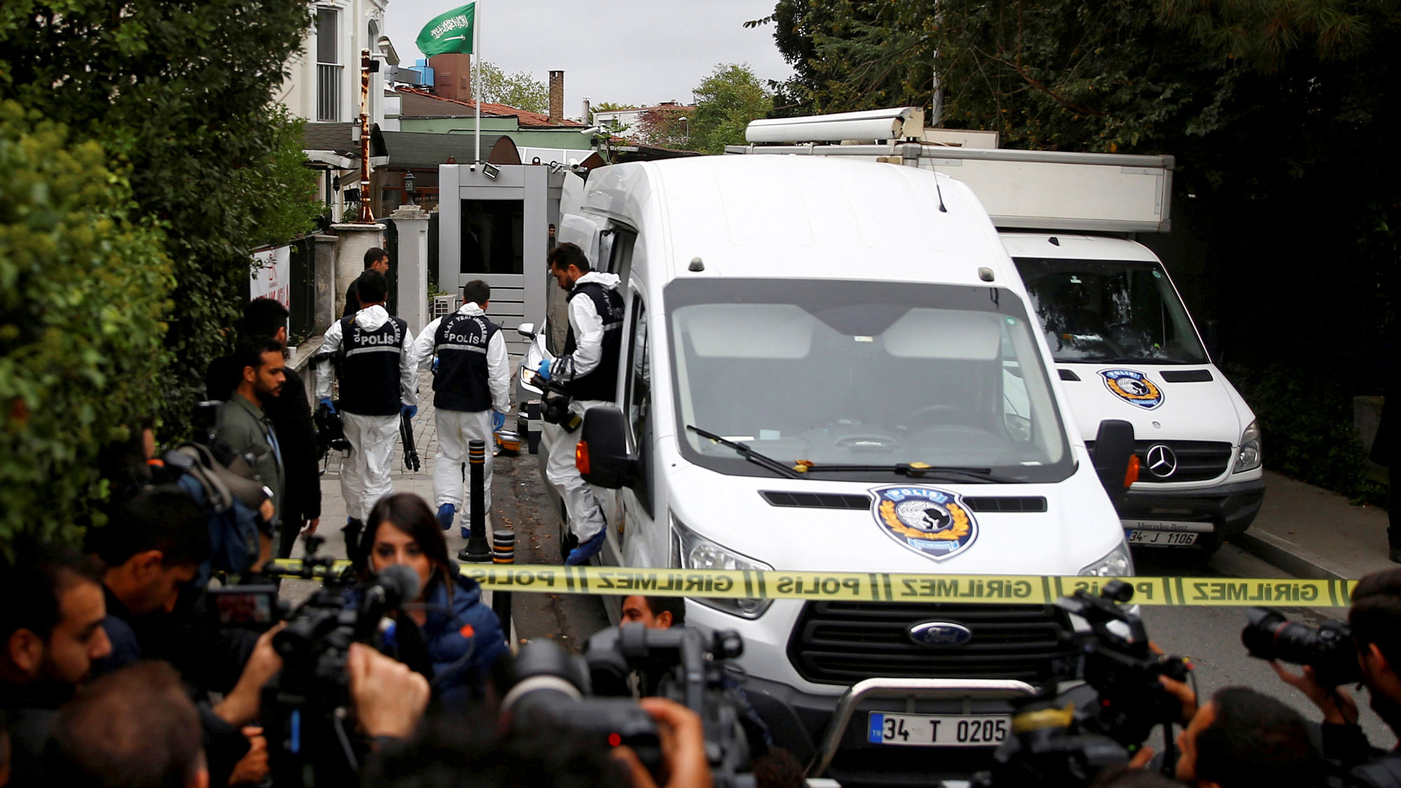Turkish forensic officials arrive clad in white uniforms and a white van to the residence of Saudi Arabia's Consul General Mohammad al-Otaibi in Istanbul, Turkey.