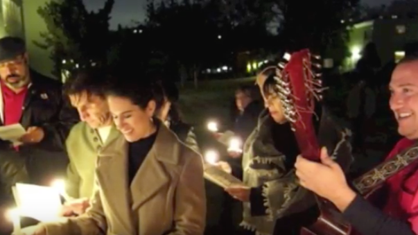 A group of carolers holding candles