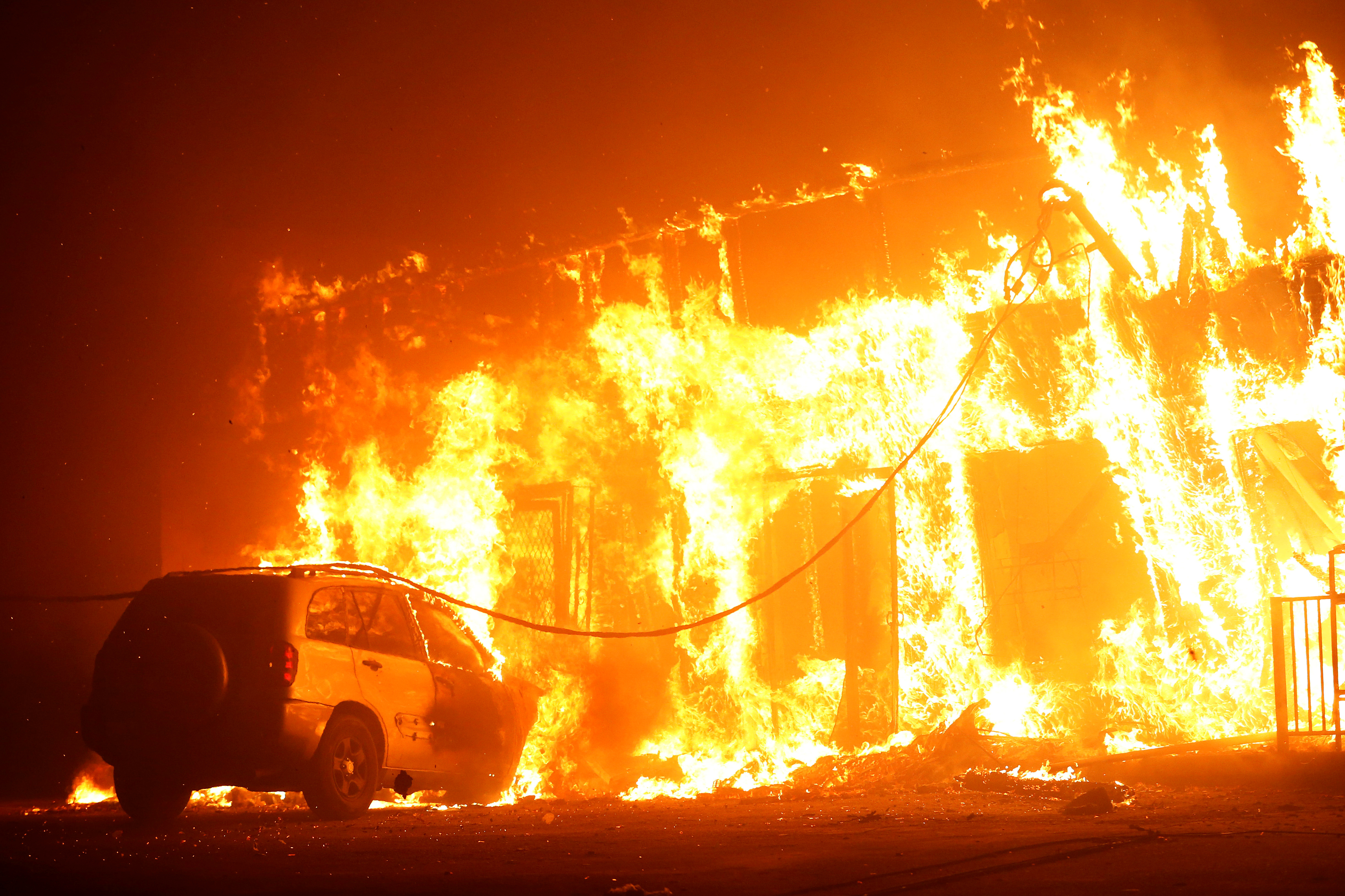 A structure is seen engulfed in flames during the Camp Fire