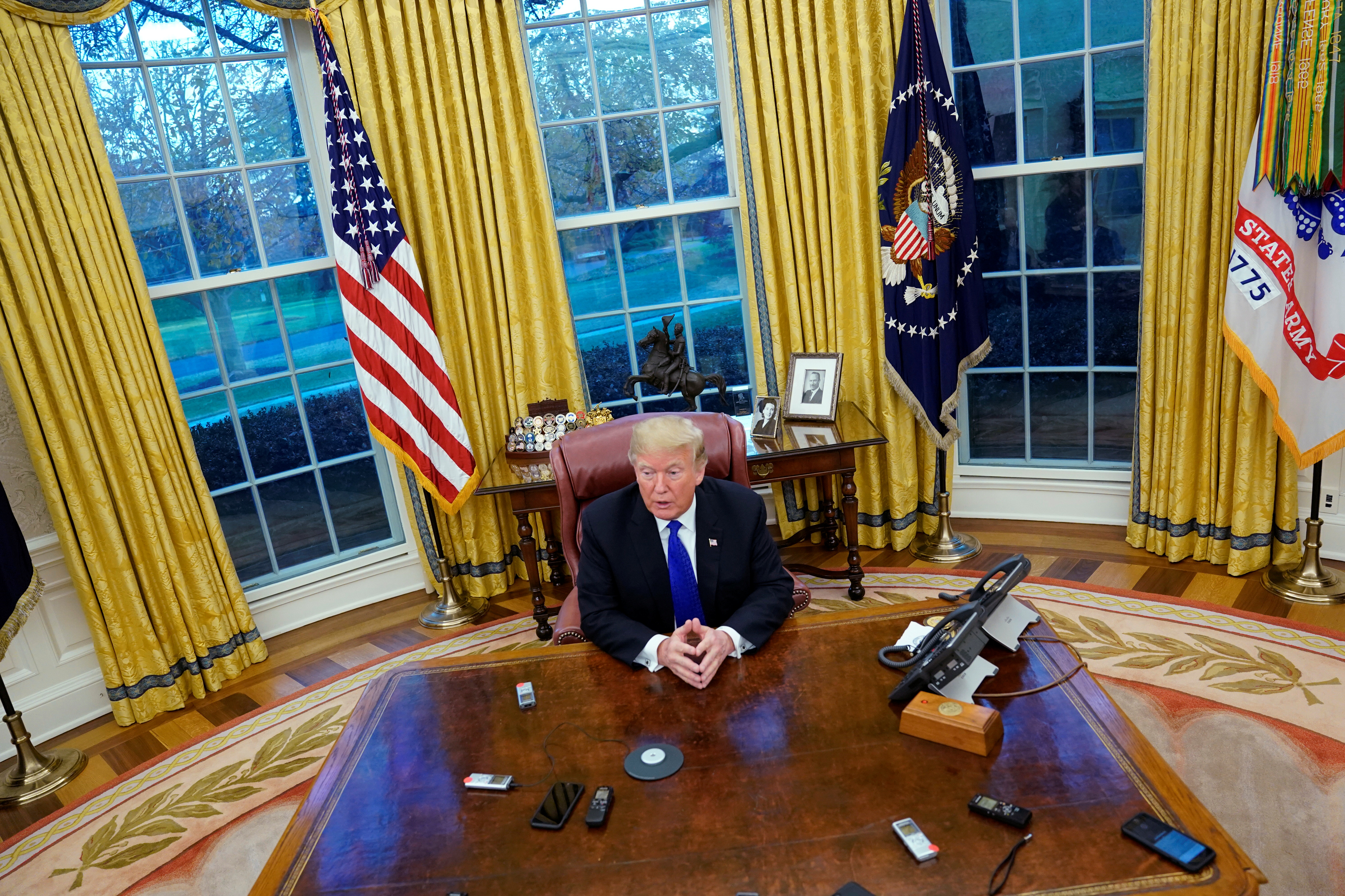 "President Donald Trump answers questions during an exclusive interview with Reuters journalists in the Oval Office at the White House in Washington,  DC on December 11, 2018. Asked about his past business connections with Russia, Trump said, ""The stuff yo"
