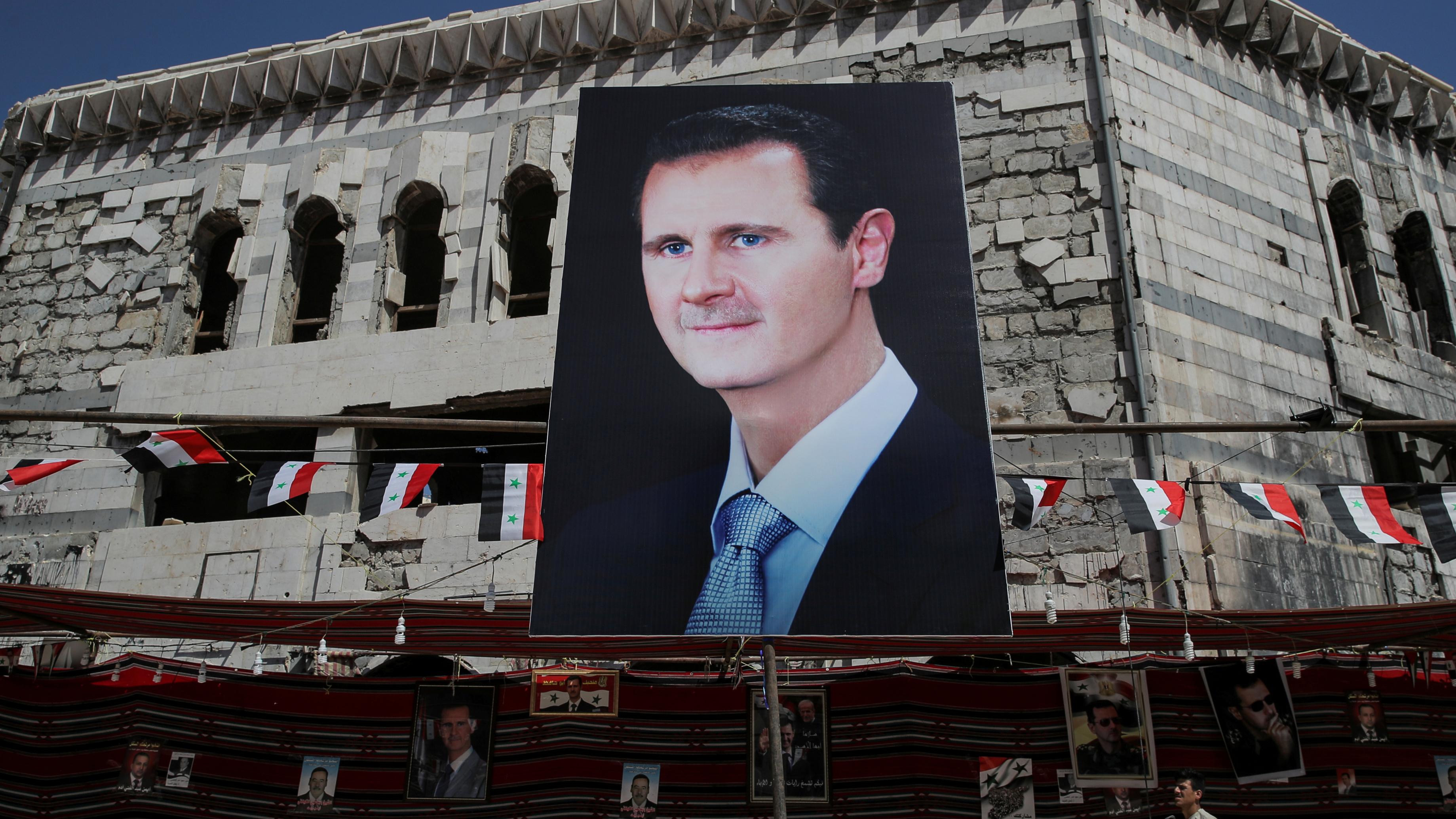 A huge banner of Bashar al-Assad.
