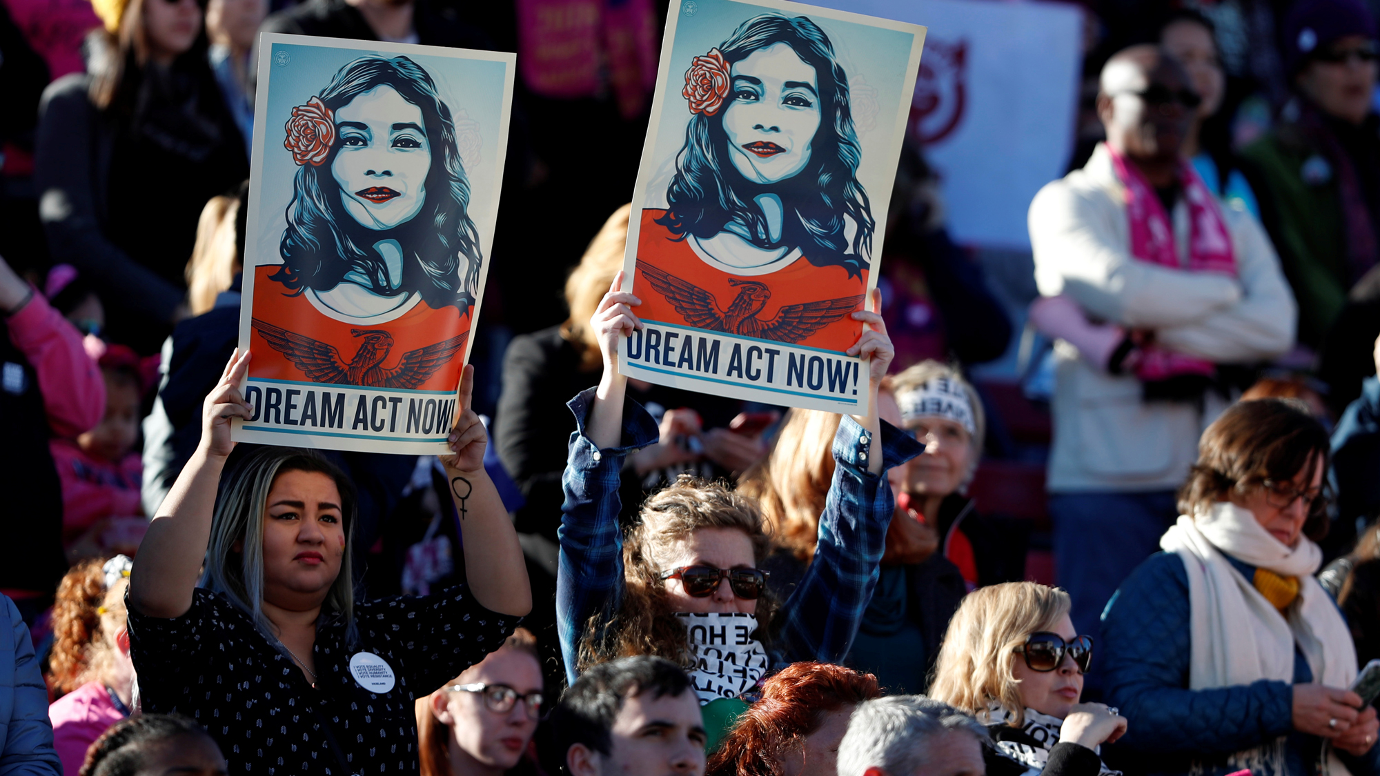 Supporters of Deferred Action for Childhood Arrivals (DACA) hold signs during the Women's March rally in Las Vegas, Jan. 21, 2018.