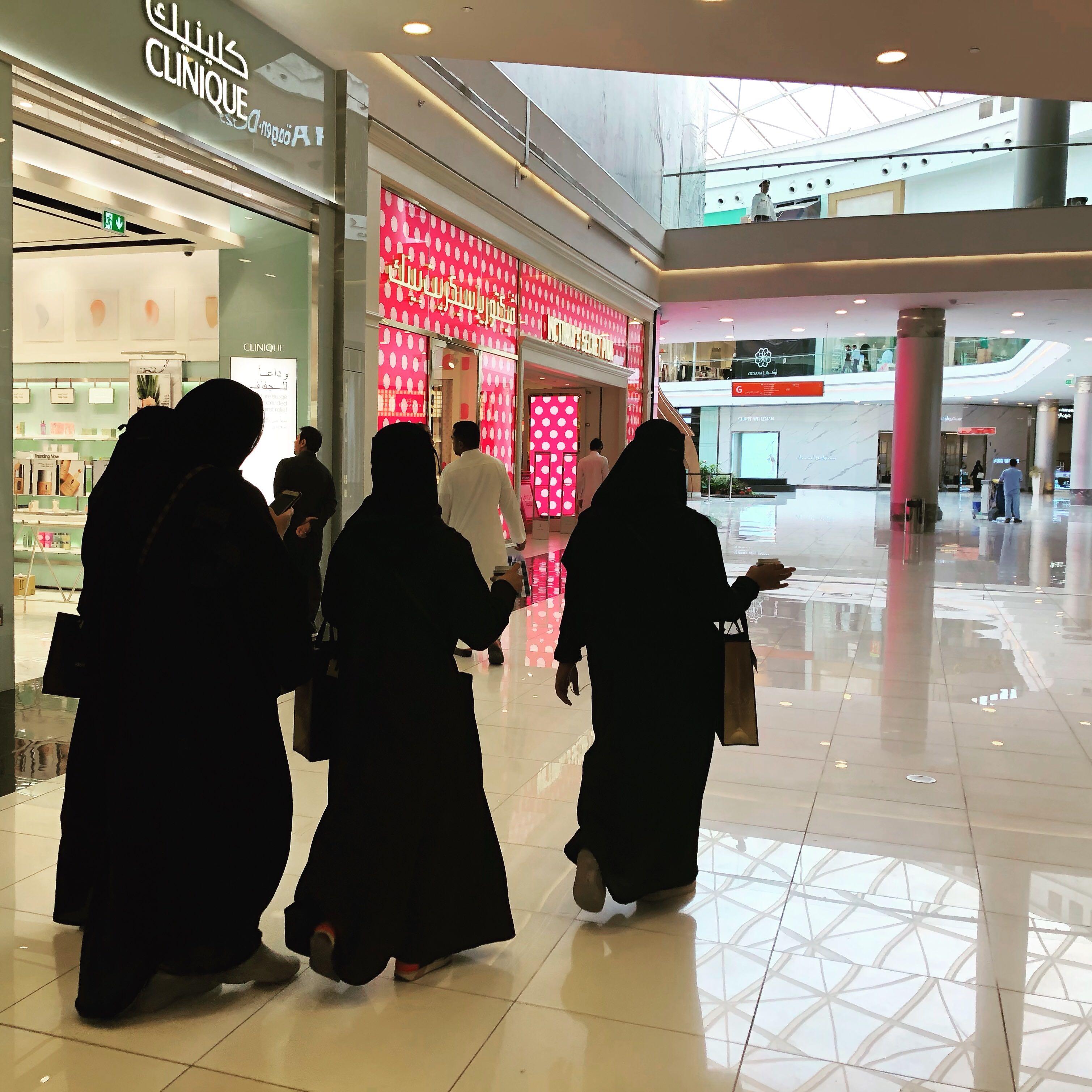 Women wearing black abaya at a mall in Saudi Arabia.