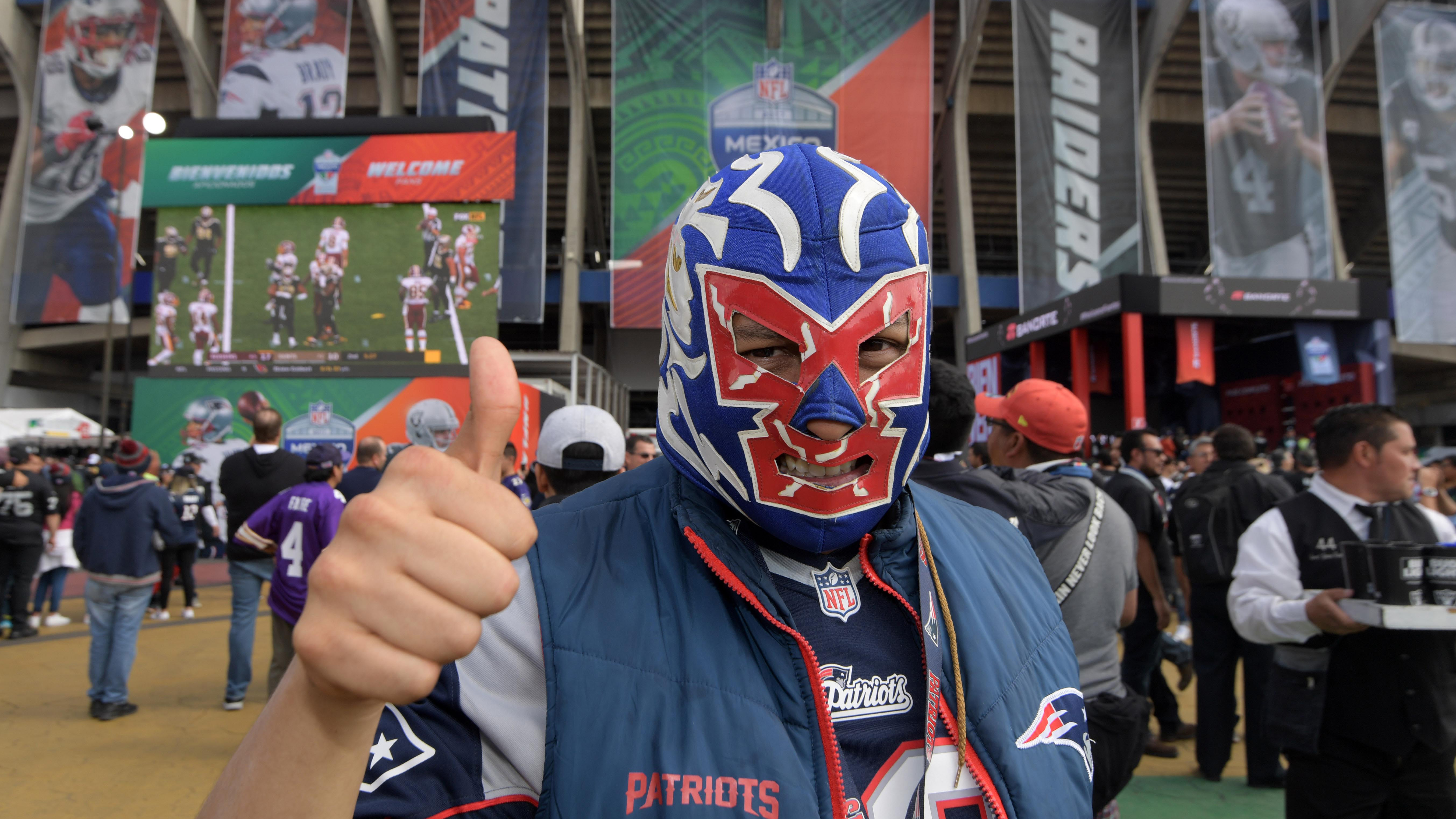 A Patriots fan poses before a NFL International Series game in Mexico City in November 2017. The Patriots have become Mexico's team. Winning helps. The Patriots are heading to their 11th Super Bowl on Sunday, and ninth since 2002, the most of any NFL fran
